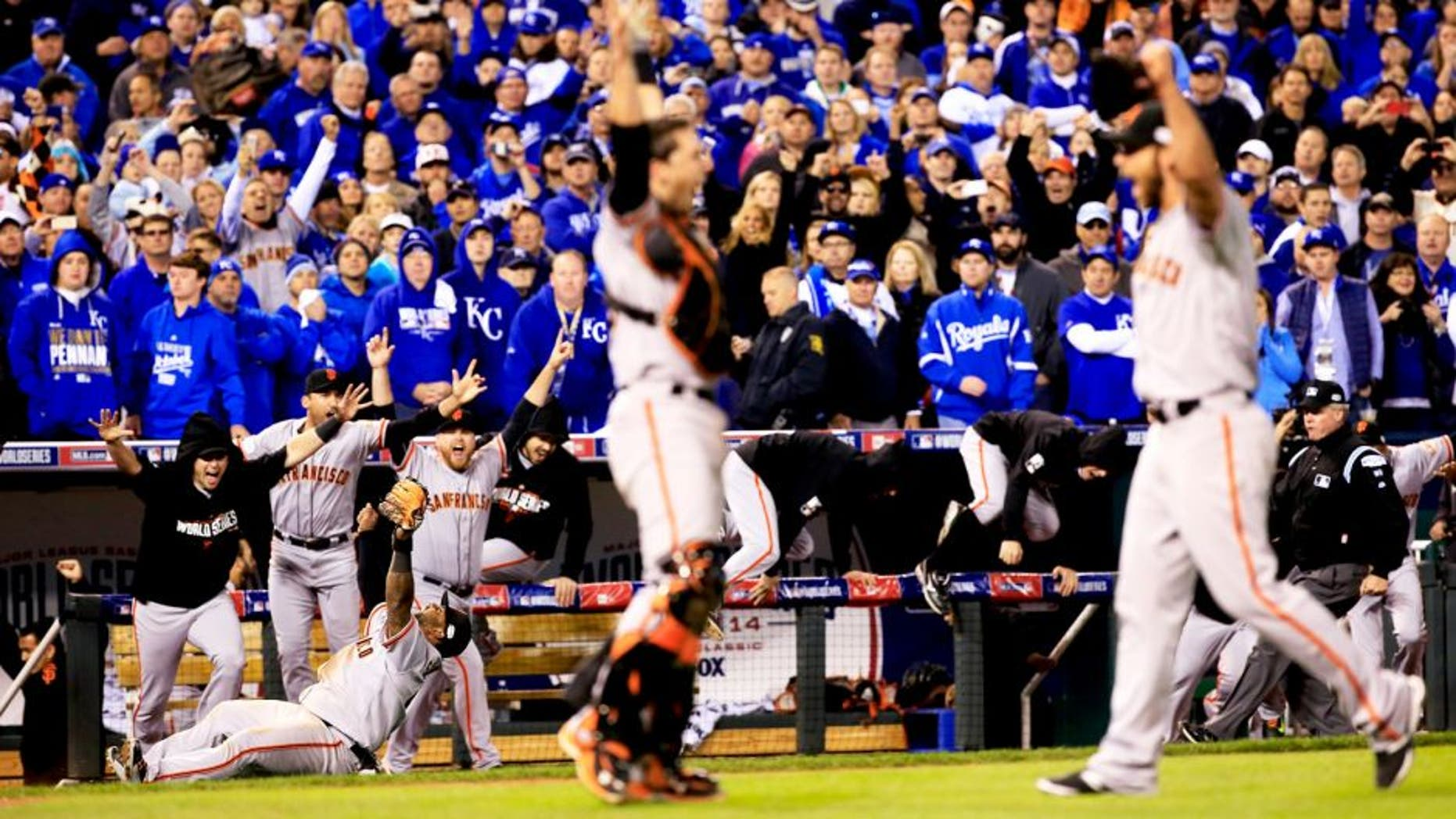 KANSAS CITY, MO - OCTOBER 29: Buster Posey #28 , Madison Bumgarner #40, Pablo Sandoval #48 and the San Francisco Giants celebrate after defeating the Kansas City Royals to win Game Seven of the 2014 World Series by a score of 3-2 at Kauffman Stadium on October 29, 2014 in Kansas City, Missouri. (Photo by Jamie Squire/Getty Images)