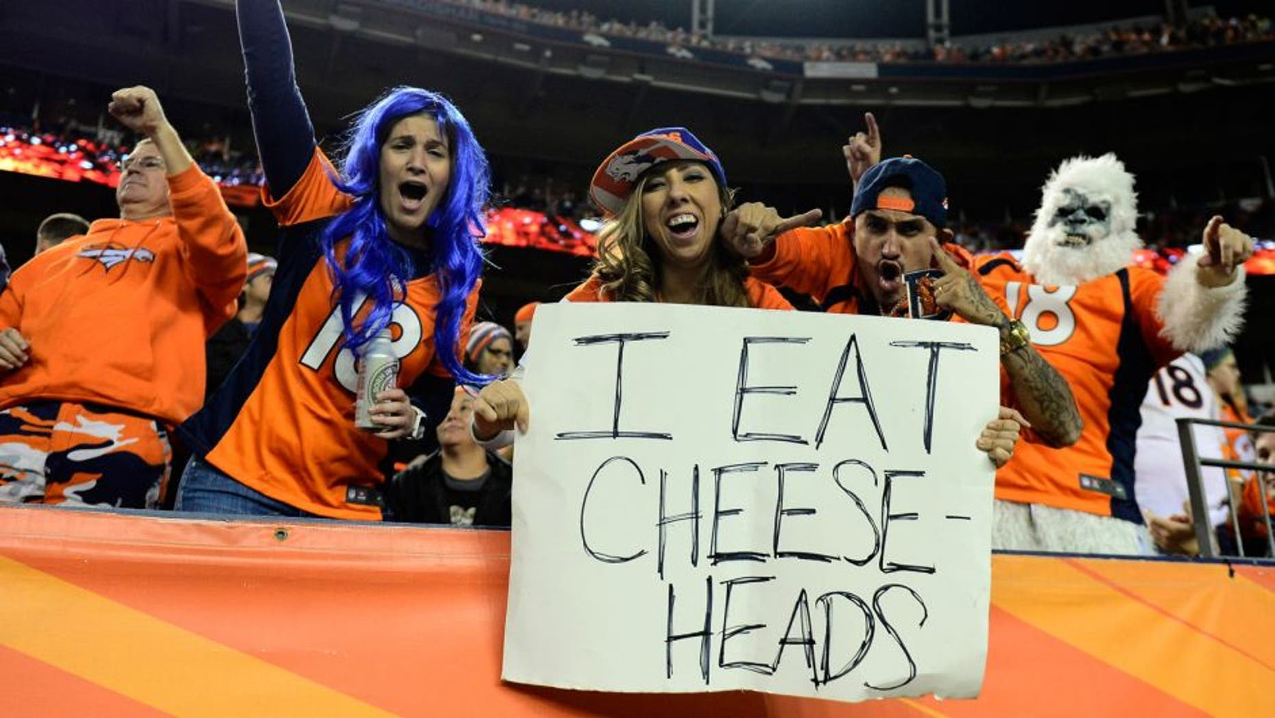 Nov 1, 2015; Denver, CO, USA; Denver Broncos fans react to the win over the Green Bay Packers at Sports Authority Field at Mile High. The Broncos defeated the Packer 29-10. Mandatory Credit: Ron Chenoy-USA TODAY Sports
