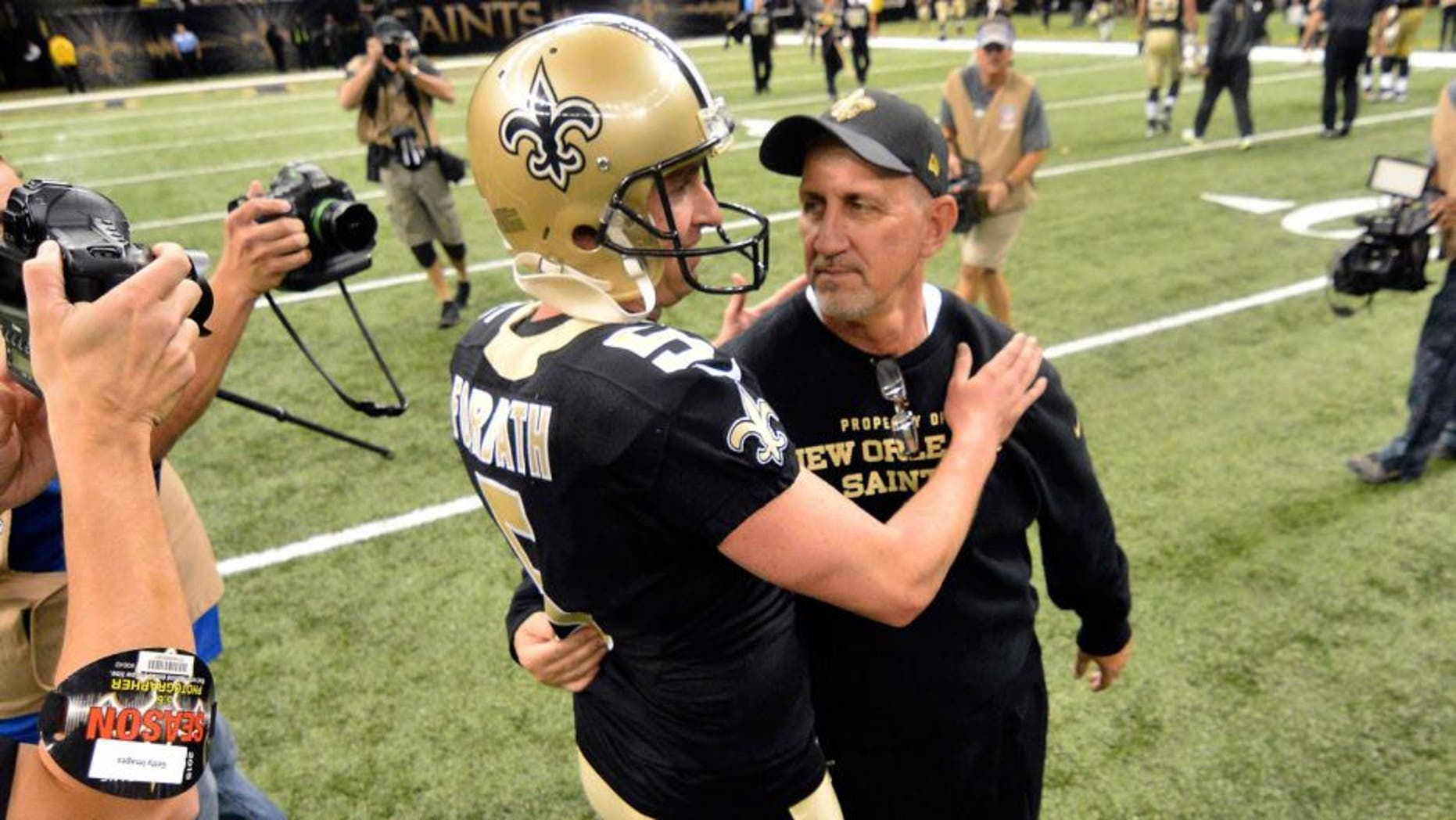 Nov 1, 2015; New Orleans, LA, USA;New Orleans Saints kicker Kai Forbath (5) and special teams coordinator Greg McMahon celebrate the winning field goal after the game against the New York Giants at the Mercedes-Benz Superdome. New Orleans won 52-49. Mandatory Credit: Matt Bush-USA TODAY Sports