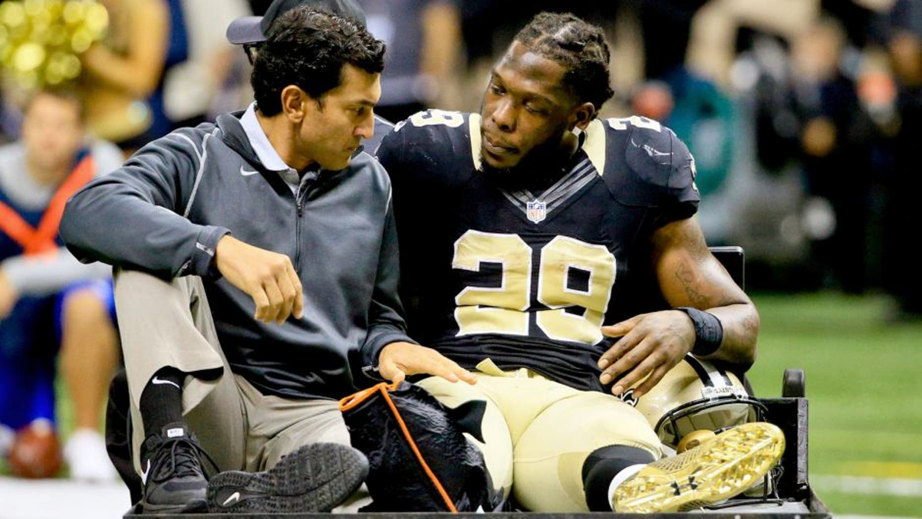 Nov 1, 2015; New Orleans, LA, USA; New Orleans Saints running back Khiry Robinson (29) is carted off the field following a leg injury against the New York Giants during the second quarter of a game at the Mercedes-Benz Superdome. Mandatory Credit: Derick E. Hingle-USA TODAY Sports