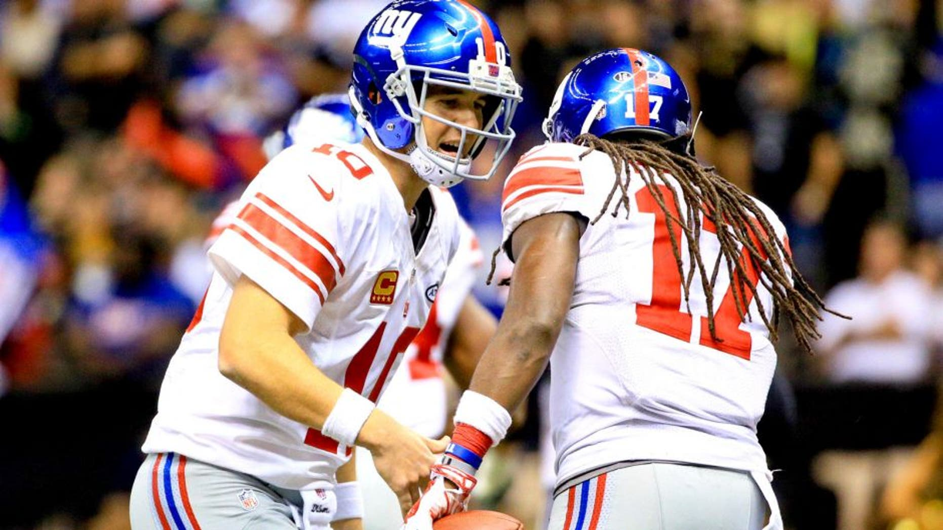 Nov 1, 2015; New Orleans, LA, USA; New York Giants quarterback Eli Manning (10) celebrates with wide receiver Dwayne Harris (17) after a tochdown during the fourth quarter of a game against the New Orleans Saints at the Mercedes-Benz Superdome. The Saints defeated the Giants 52-49. Mandatory Credit: Derick E. Hingle-USA TODAY Sports