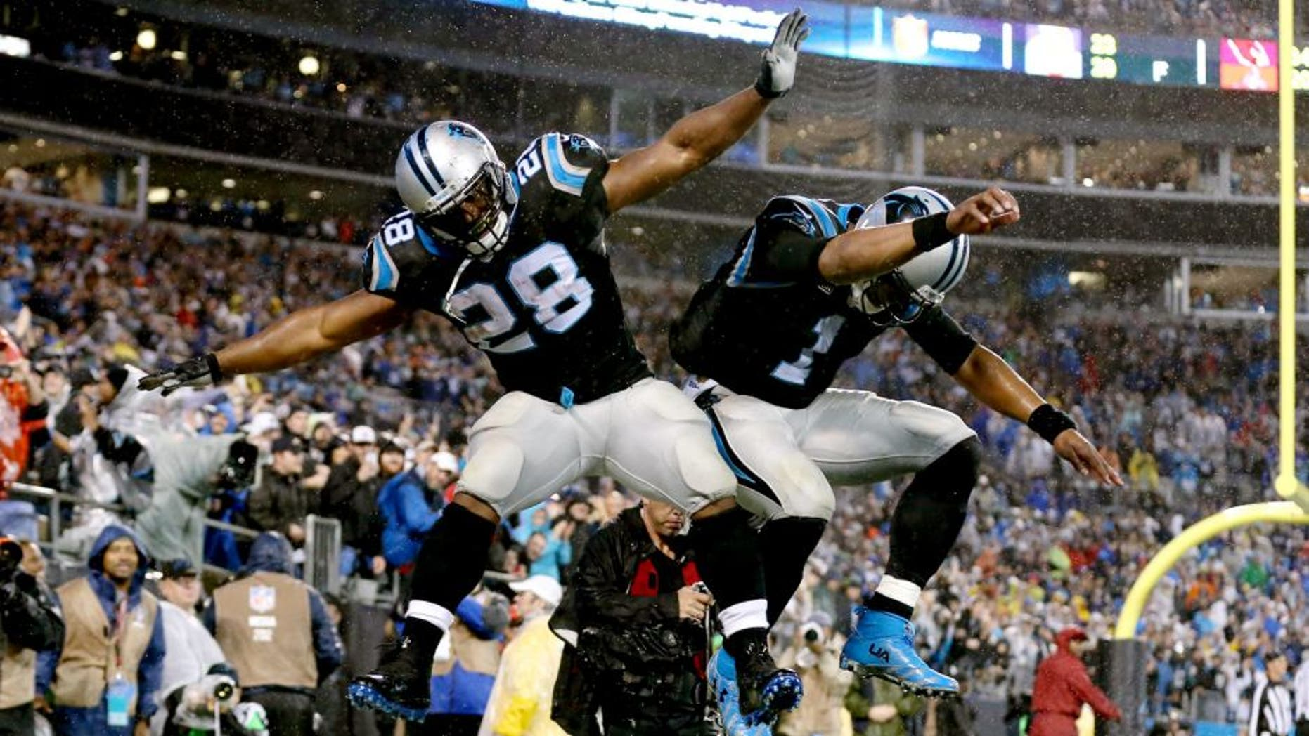 CHARLOTTE, NC - NOVEMBER 02: Cam Newton #1 and teammate Jonathan Stewart #28 of the Carolina Panthers celebrate after a touchdown against the Indianapolis Colts in the 1st quarter during their game at Bank of America Stadium on November 2, 2015 in Charlotte, North Carolina. (Photo by Streeter Lecka/Getty Images)