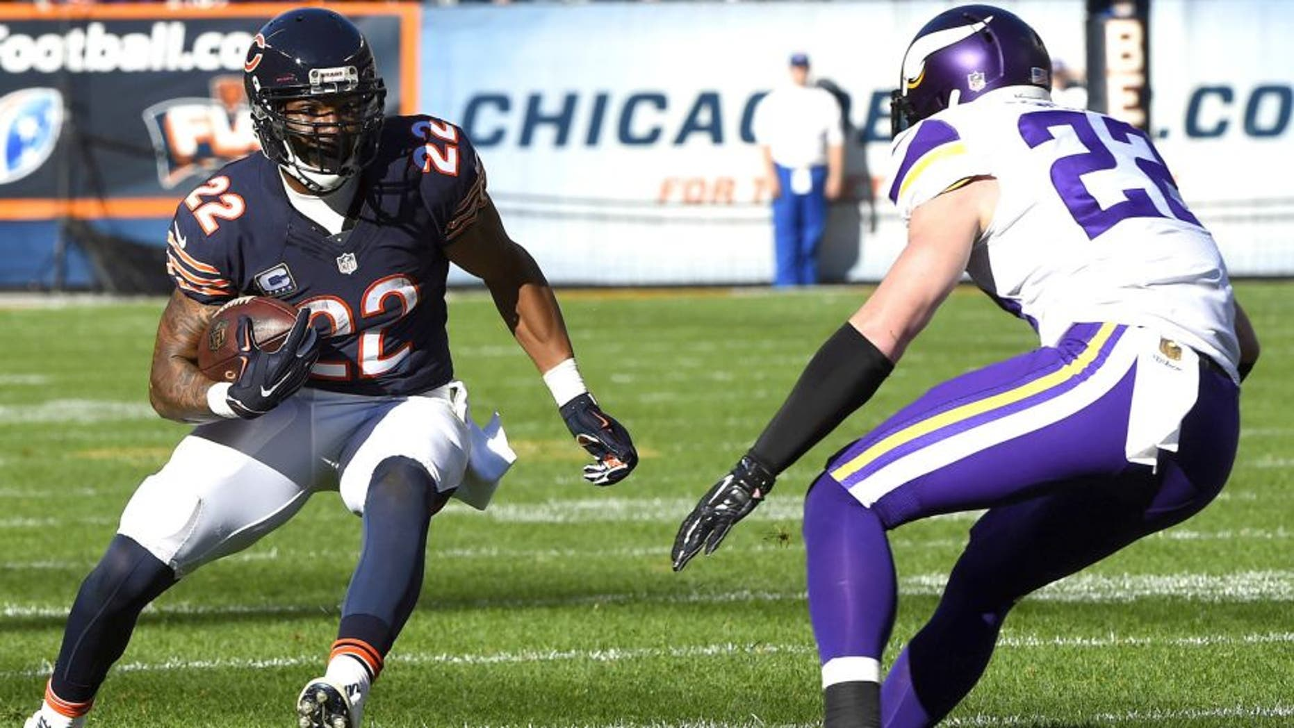 Nov 1, 2015; Chicago, IL, USA; Chicago Bears running back Matt Forte (22) carries the ball as Minnesota Vikings free safety Harrison Smith (22) defends during the second half at Soldier Field. Mandatory Credit: Mike DiNovo-USA TODAY Sports