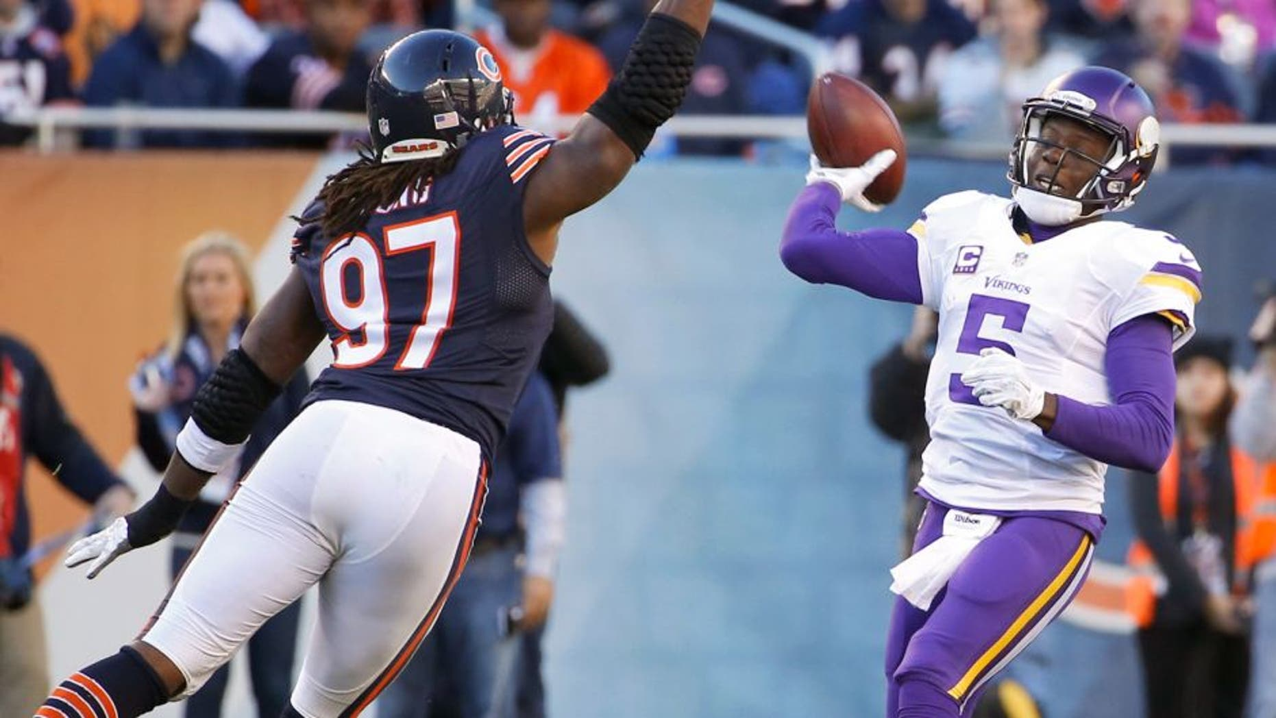 Nov 1, 2015; Chicago, IL, USA; Minnesota Vikings quarterback Teddy Bridgewater (5) throws the ball over Chicago Bears outside linebacker Willie Young (97) during the fourth quarter at Soldier Field. The Vikings won 23-20. Mandatory Credit: Kamil Krzaczynski-USA TODAY Sports