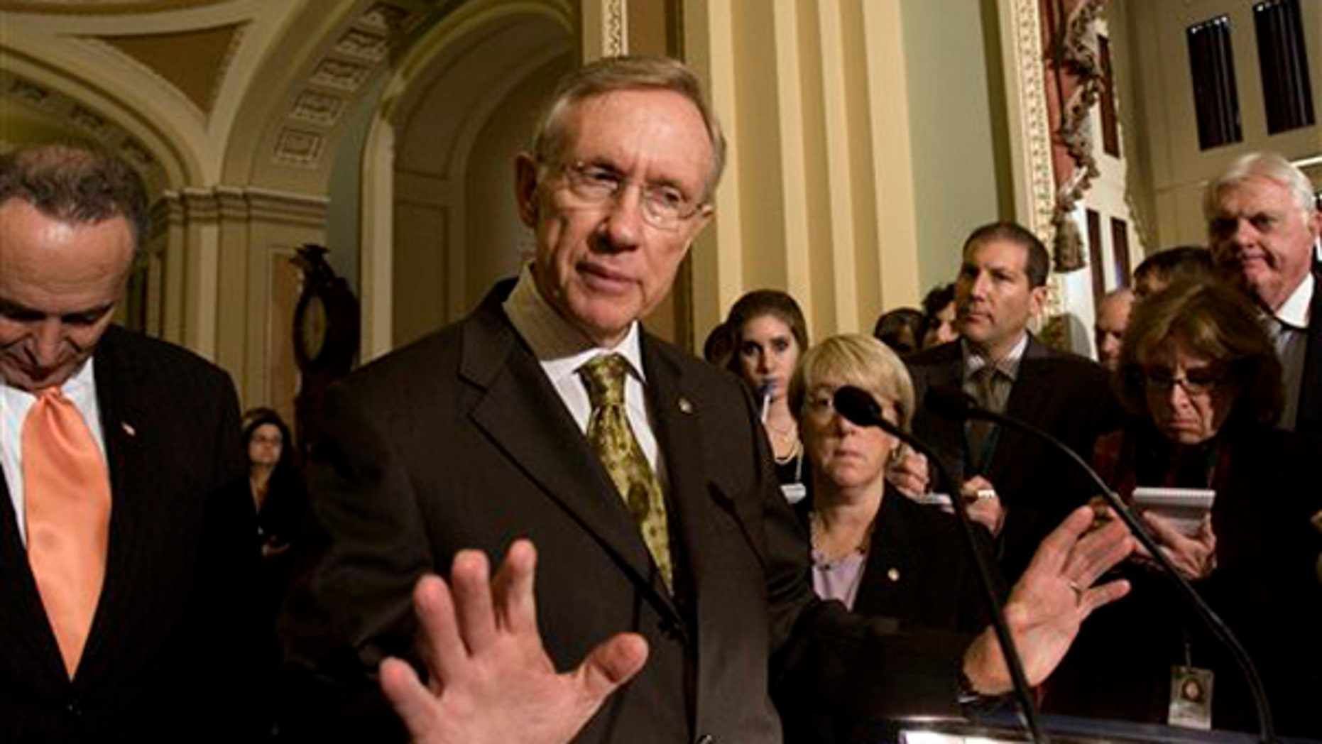 Senate Majority Leader Harry Reid of Nev. gestures on Capitol Hill, Tuesday, Nov. 3, 2009, following  the weekly caucus luncheons. Sen. Charles Schumer, D-N.Y. is at left. (AP Photo)