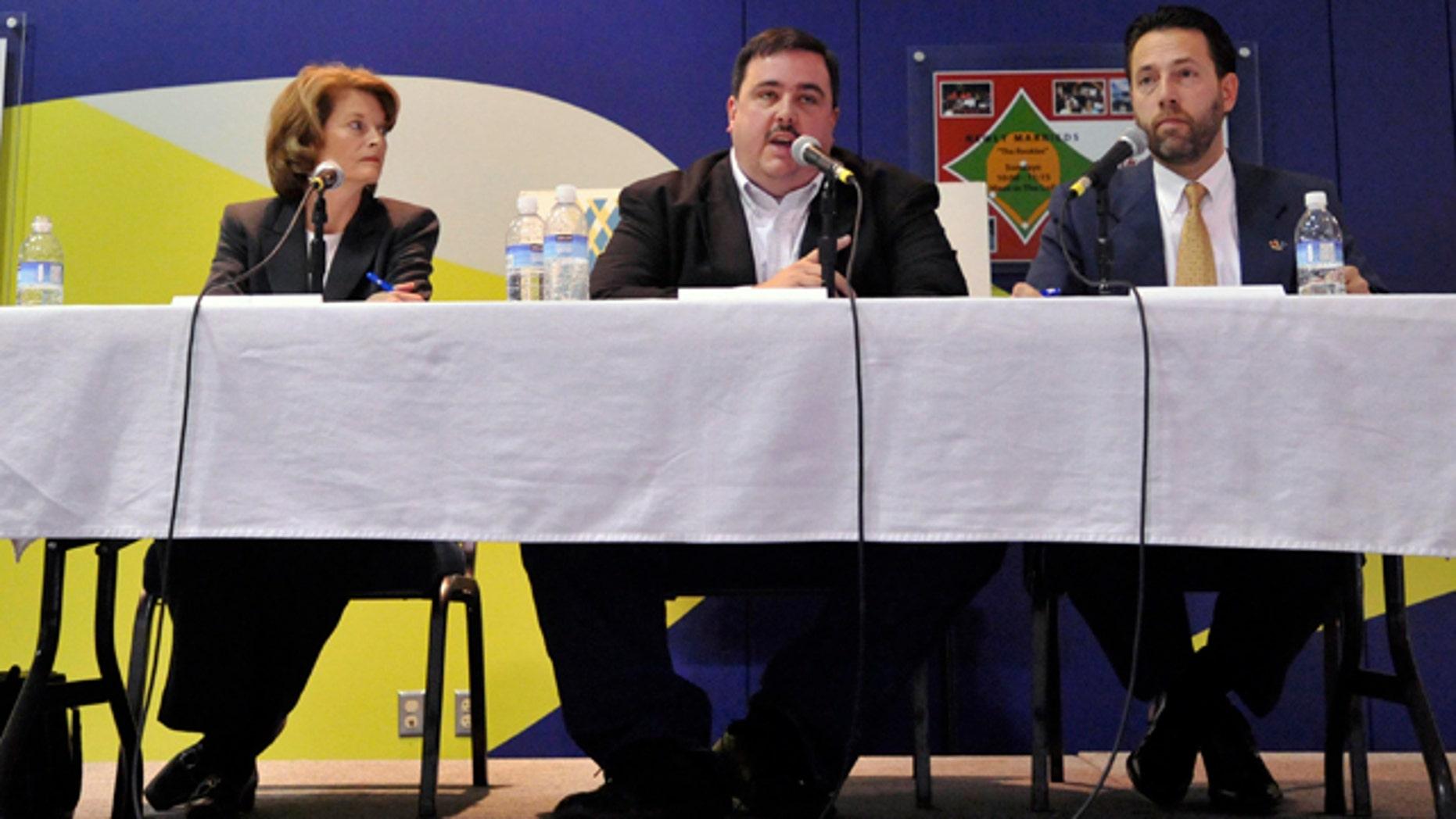 Oct. 7: U.S. Sen. Lisa Murkowski, R-Alaska, left, Democrat Scott McAdams, center, and Republican Joe Miller face off in a debate in Anchorage, Alaska.