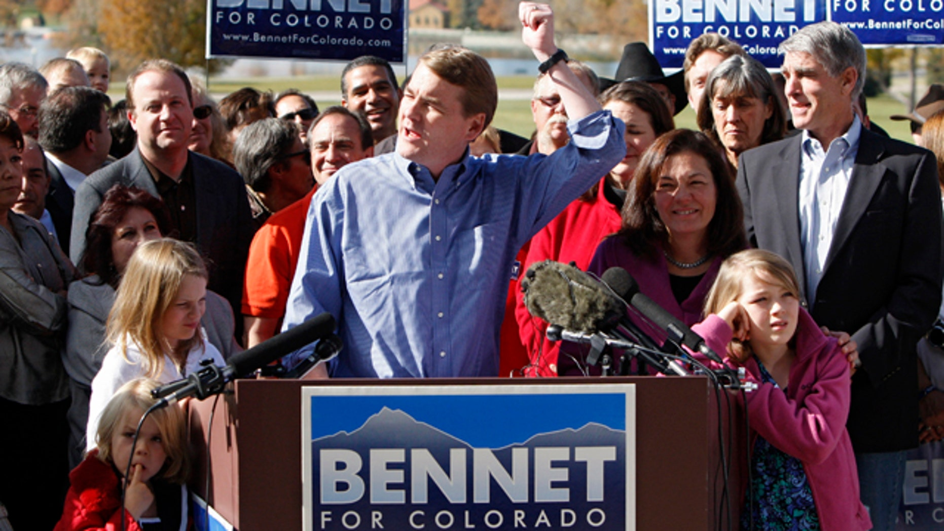 Nov. 3: Sen. Michael Bennet, D-Colo., flanked by his wife Susan Daggett and their three children, delivers his victory speech at Denver's City Park.