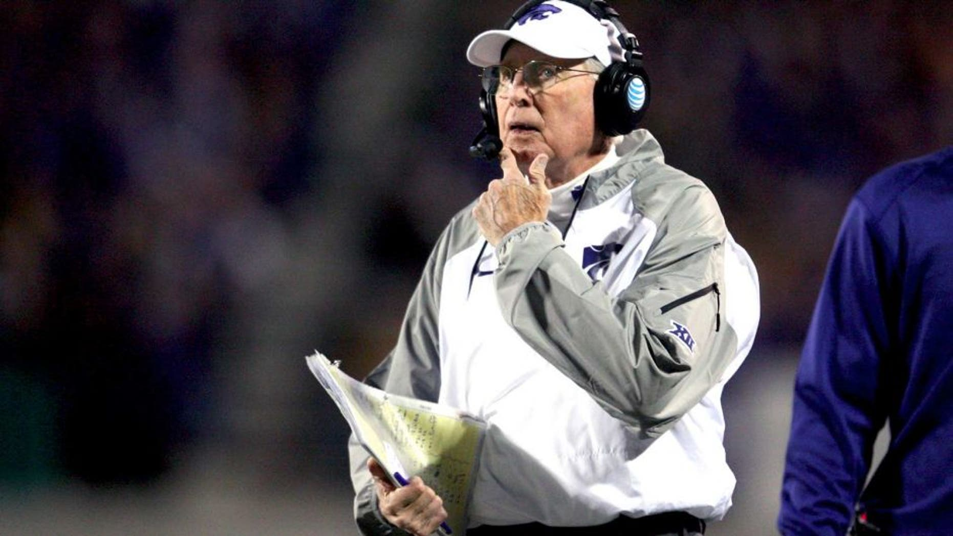 Nov 1, 2014; Manhattan, KS, USA; Kansas State Wildcats head coach Bill Snyder looks at the scoreboard during first-half action against the Oklahoma State Cowboys at Bill Snyder Family Stadium. Mandatory Credit: Scott Sewell-USA TODAY Sports
