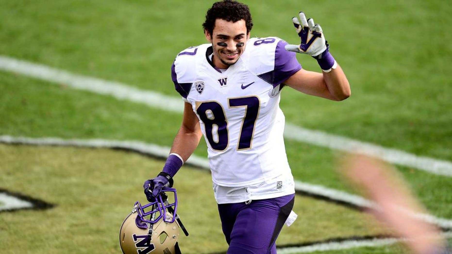 Nov 1, 2014; Boulder, CO, USA; Washington Huskies wide receiver Dante Pettis (87) reacts following the win over the Colorado Buffaloes at Folsom Field. The Huskies defeated the Buffaloes 38-23. Mandatory Credit: Ron Chenoy-USA TODAY Sports