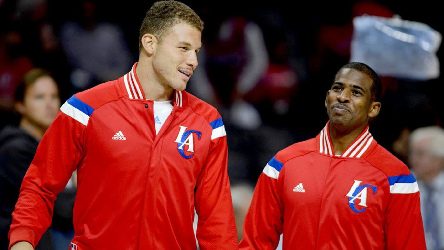 Nov 2, 2014; Los Angeles, CA, USA; Los Angeles Clippers forward Blake Griffin (left) talks with Los Angeles Clippers guard Chris Paul (right) prior to the game against the Sacramento Kings at Staples Center. Mandatory Credit: Kelvin Kuo-USA TODAY Sports