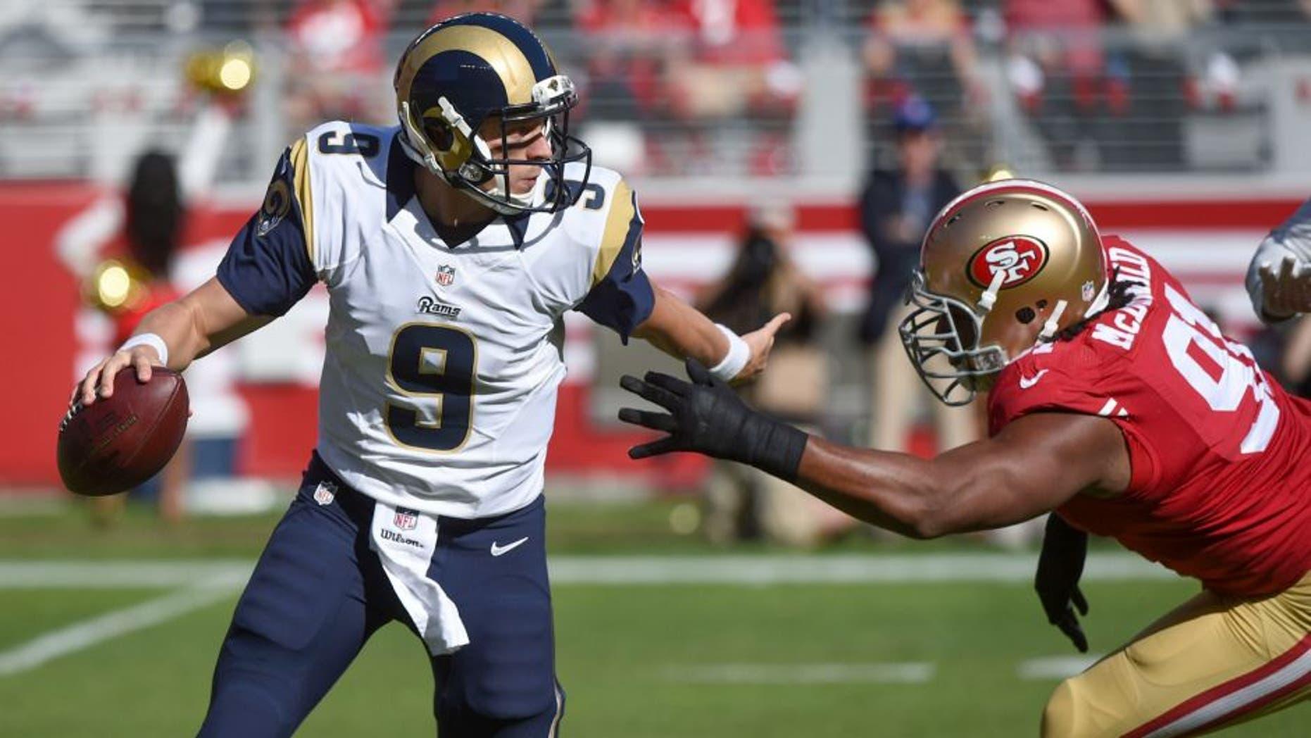 November 2, 2014; Santa Clara, CA, USA; St. Louis Rams quarterback Austin Davis (9) scrambles from San Francisco 49ers defensive end Ray McDonald (91) during the first quarter at Levi's Stadium. Mandatory Credit: Kyle Terada-USA TODAY Sports