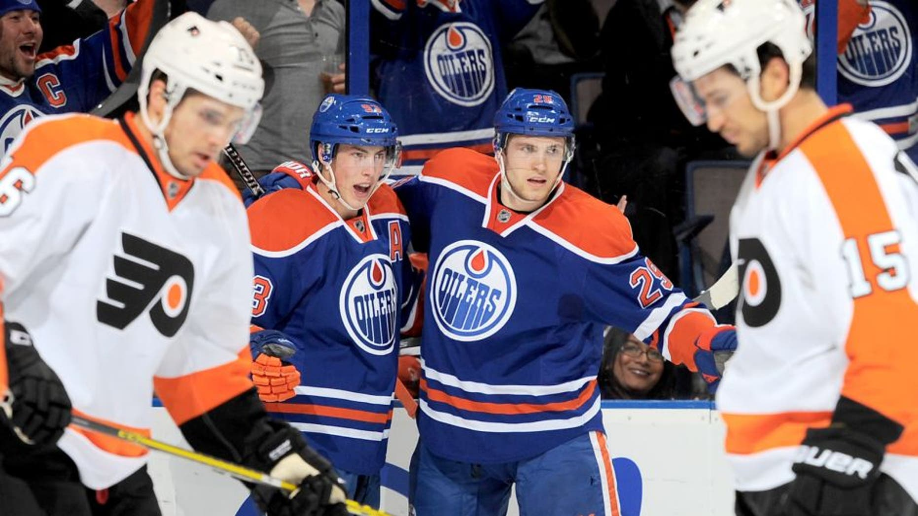 EDMONTON, AB - NOVEMBER 3: Ryan Nugent-Hopkins #93 and Leon Draisaitl #29 of the Edmonton Oilers celebrate after a goal during a game against the Philadelphia Flyers on November 3, 2015 at Rexall Place in Edmonton, Alberta, Canada. (Photo by Andy Devlin/NHLI via Getty Images)