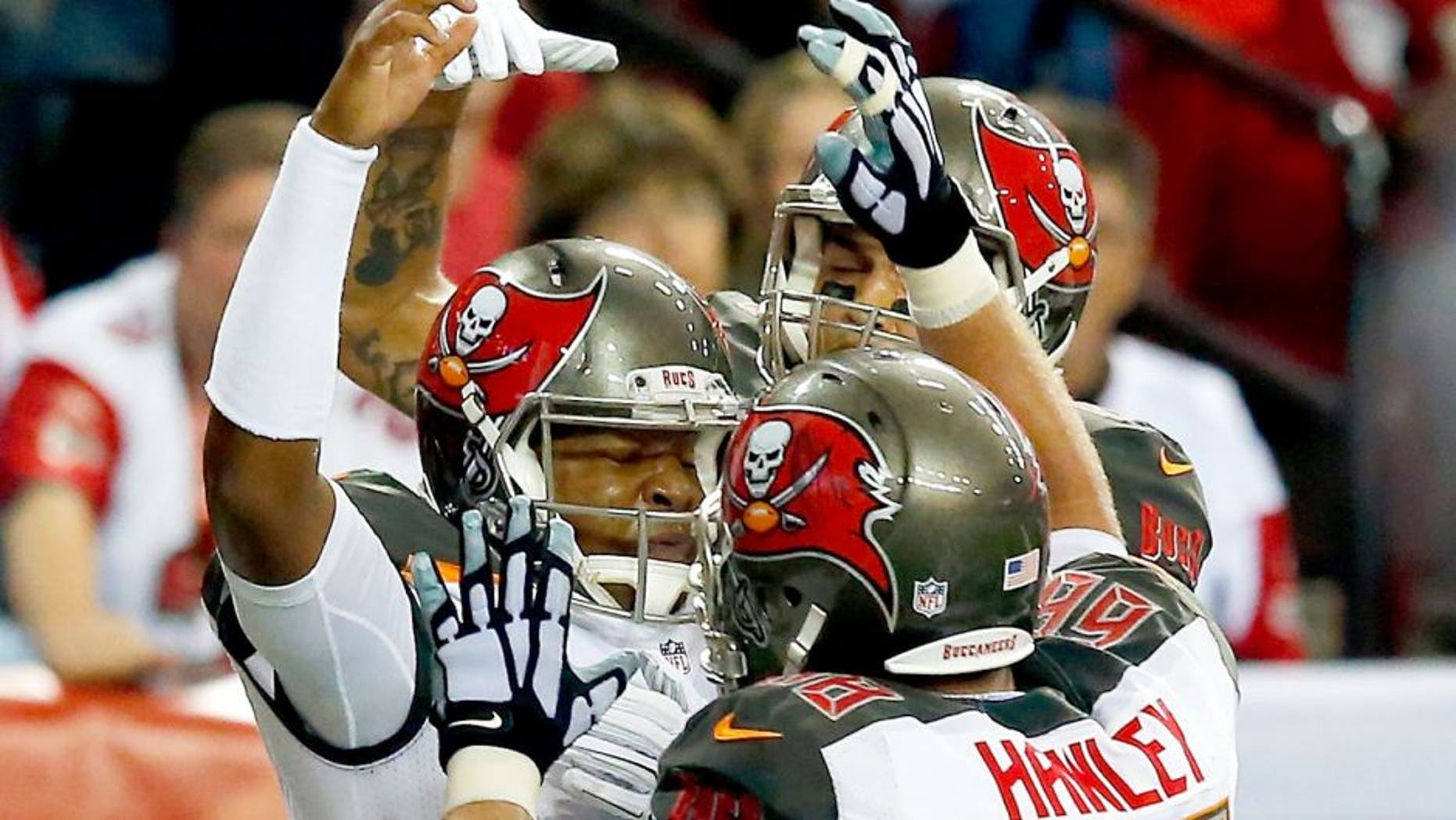 ATLANTA, GA - NOVEMBER 01: Jameis Winston #3 of the Tampa Bay Buccaneers celebrates a touchdown with Joe Hawley #68 of the Tampa Bay Buccaneers during the second half against the Atlanta Falcons at the Georgia Dome on November 1, 2015 in Atlanta, Georgia. (Photo by Kevin C. Cox/Getty Images)