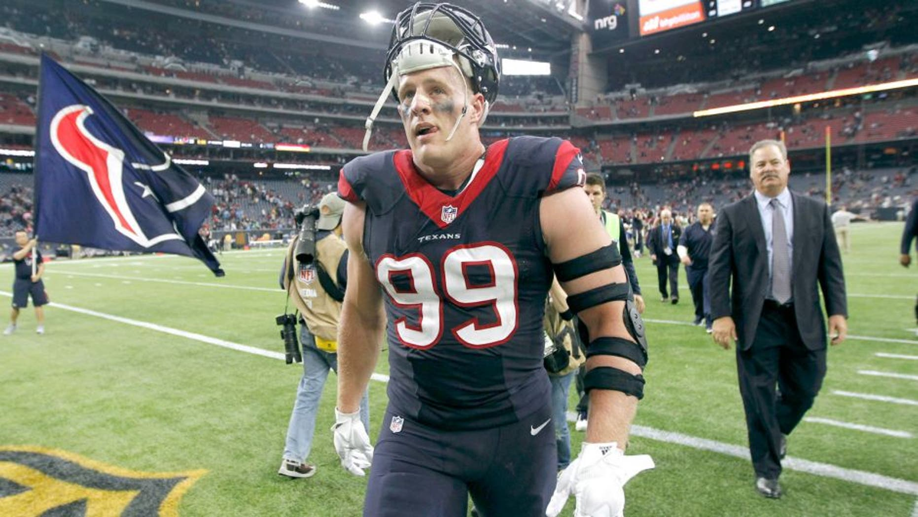Nov 1, 2015; Houston, TX, USA; Houston Texans defensive end J.J. Watt (99) leaves the field after beating the Tennessee Titans 20-6 at NRG Stadium. Mandatory Credit: Erich Schlegel-USA TODAY Sports