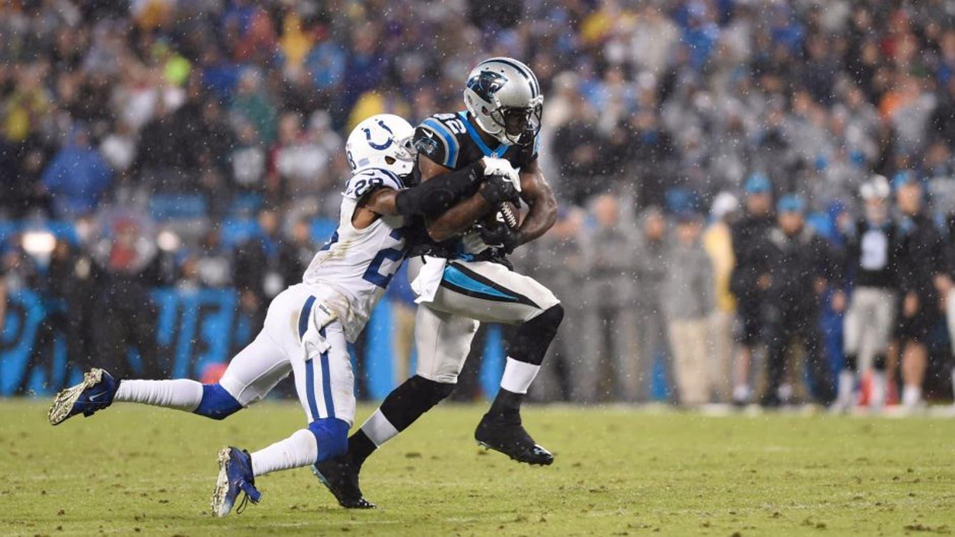 Nov 2, 2015; Charlotte, NC, USA; Carolina Panthers running back Jonathan Stewart (28) runs as Indianapolis Colts cornerback Greg Toler (28) defends in the first quarter at Bank of America Stadium. Mandatory Credit: Bob Donnan-USA TODAY Sports