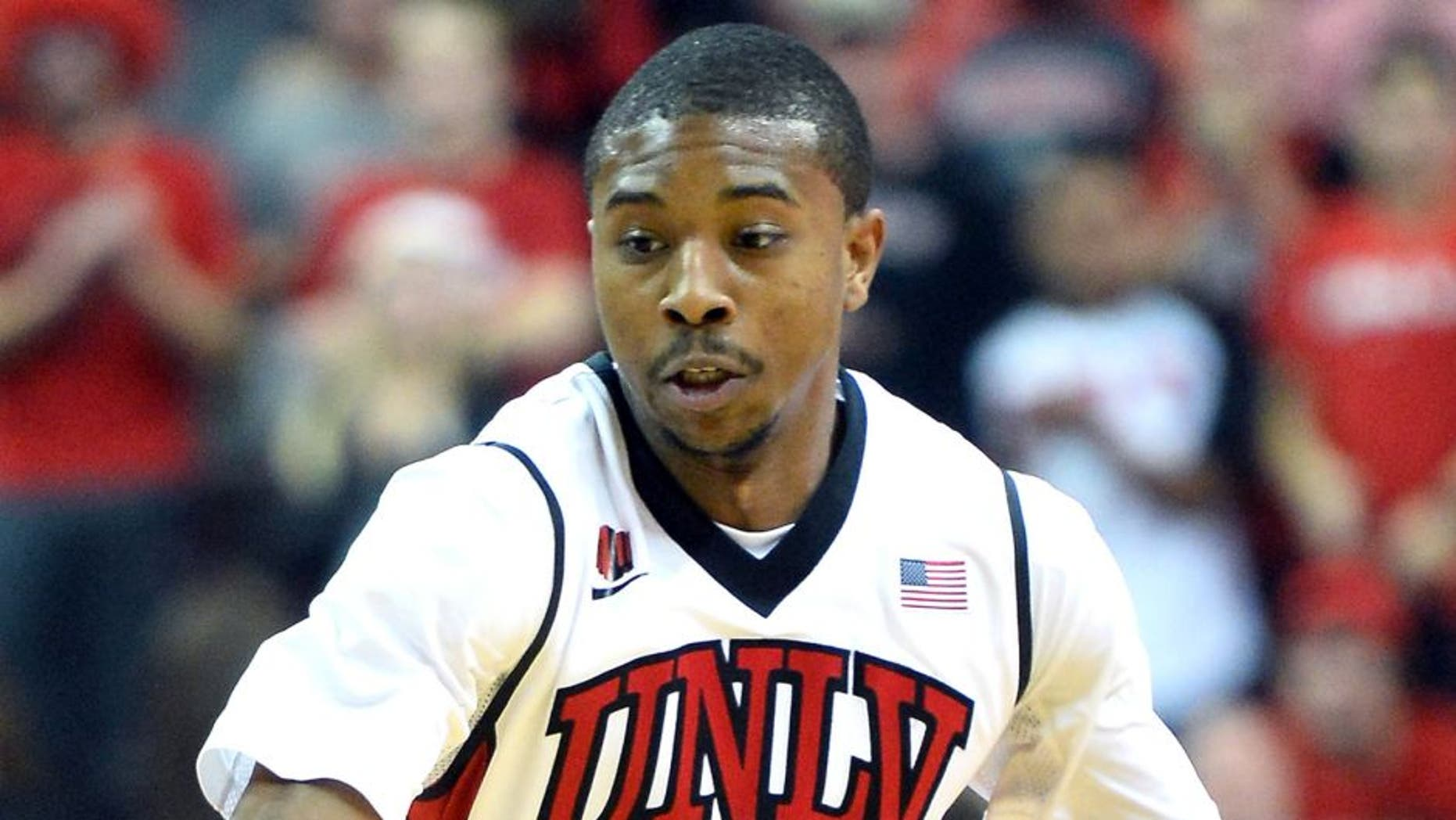 LAS VEGAS, NV - NOVEMBER 26: Daquan Cook #10 of the UNLV Rebels brings the ball up the court against the Illinois Fighting Illini during their game at the Thomas & Mack Center on November 26, 2013 in Las Vegas, Nevada. Illinois won 61-59. (Photo by Ethan Miller/Getty Images)