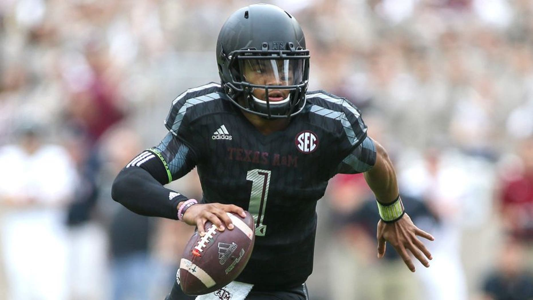 Oct 31, 2015; College Station, TX, USA; Texas A&M Aggies quarterback Kyler Murray (1) scrambles with the ball during the first quarter against the South Carolina Gamecocks at Kyle Field. Mandatory Credit: Troy Taormina-USA TODAY Sports