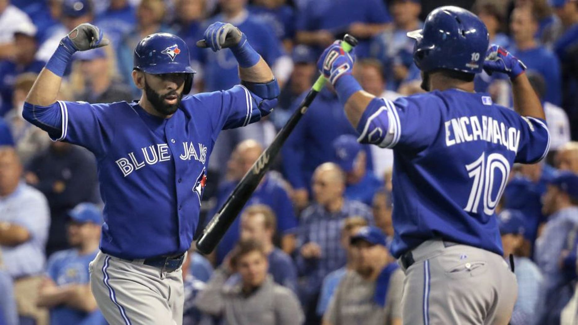 KANSAS CITY, MO - OCTOBER 23: Toronto Blue Jays right fielder Jose Bautista (19) and Toronto Blue Jays designated hitter Edwin Encarnacion (10) celebrate Bautista's 2 run home run in the top of the 8th inning to tie the game. Toronto Blue Jays Vs Kansas City Royals in Game 6 of the ALCS at Kauffman Field. Jays lose 4-3 and lose the series 4-2. Kansas City goes on to the World Series against the New York Mets. Toronto Star/Rick Madonik (Rick Madonik/Toronto Star via Getty Images)