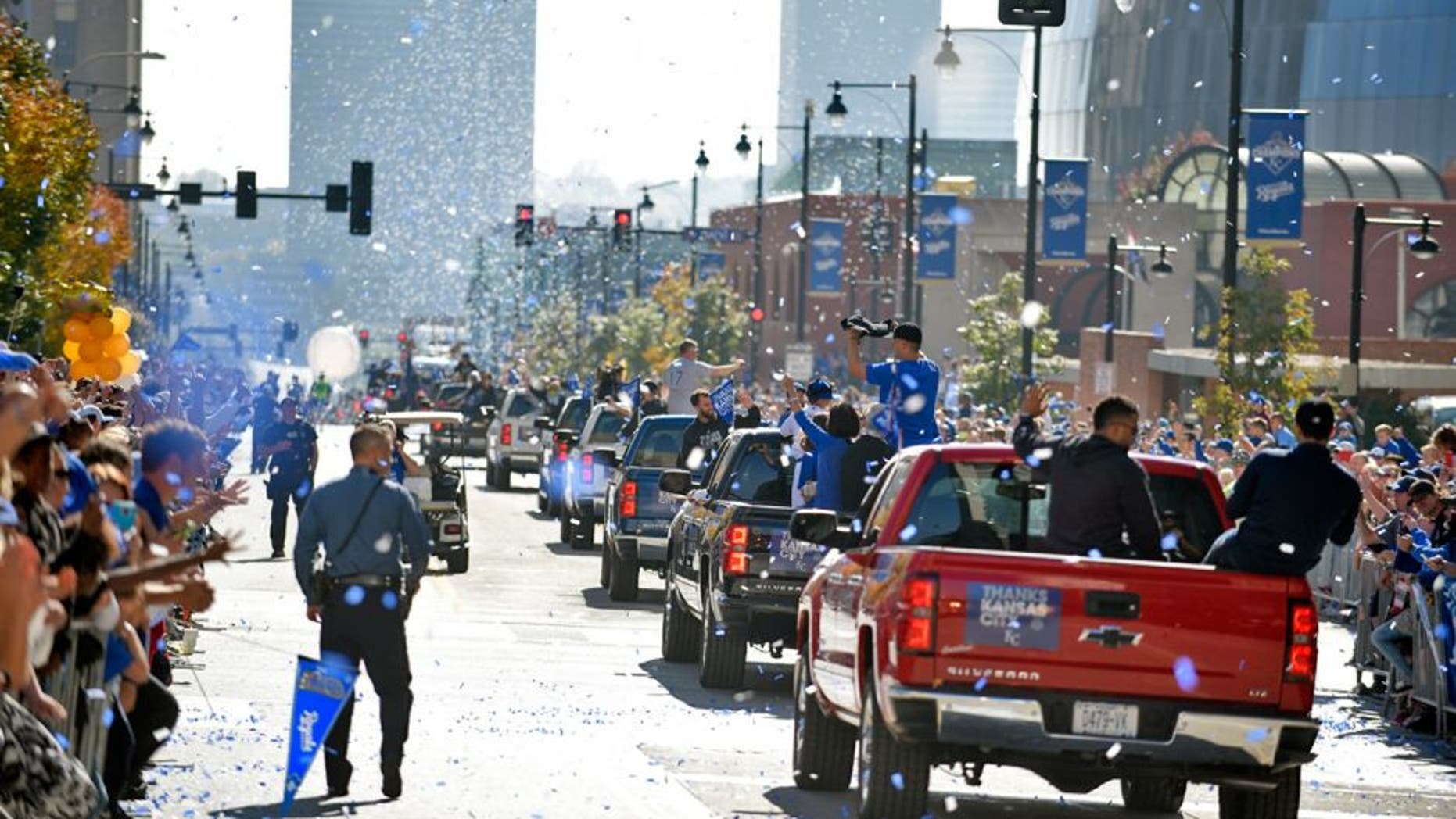 KANSAS CITY, MO -NOVEMBER 3: Members of the Kansas City Royals make their way through the steers of downtown during a parade to celebrate their World Series victory on November 3, 2015 in Kansas City, Missouri. (Photo by Ed Zurga/Getty Images)