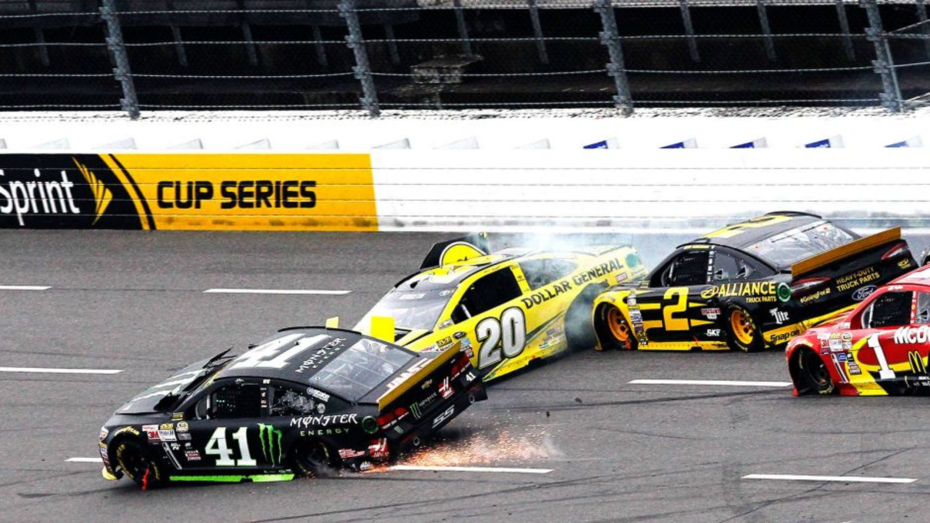 MARTINSVILLE, VA - NOVEMBER 01: Kurt Busch, driver of the #41 Monster Energy Chevrolet, Matt Kenseth, driver of the #20 Dollar General Toyota, Brad Keselowski, driver of the #2 Alliance Truck Parts Ford, and Jamie McMurray, driver of the #1 McDonald's Chevrolet, are involved in an on-track incident during the NASCAR Sprint Cup Series Goody's Headache Relief Shot 500 at Martinsville Speedway on November 1, 2015 in Martinsville, Virginia. (Photo by Brian Lawdermilk/NASCAR via Getty Images)
