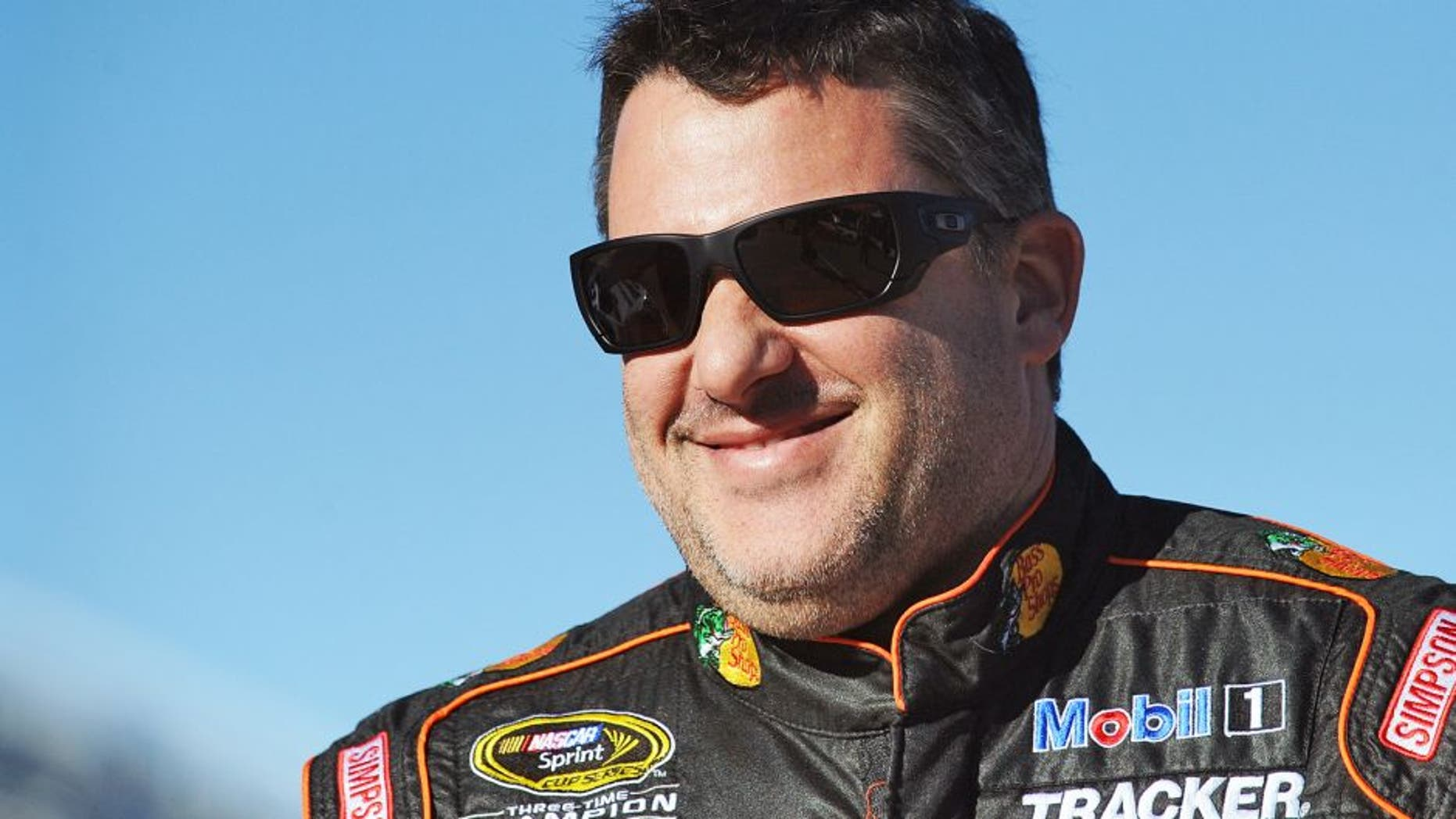 MARTINSVILLE, VA - OCTOBER 30: Tony Stewart, driver of the #14 Bass Pro Shops/Mobil 1 Chevrolet, stands on the grid during qualifying for the NASCAR Sprint Cup Series Goody's Headache Relief Shot 500 at Martinsville Speedway on October 30, 2015 in Martinsville, Virginia. (Photo by Rainier Ehrhardt/Getty Images)