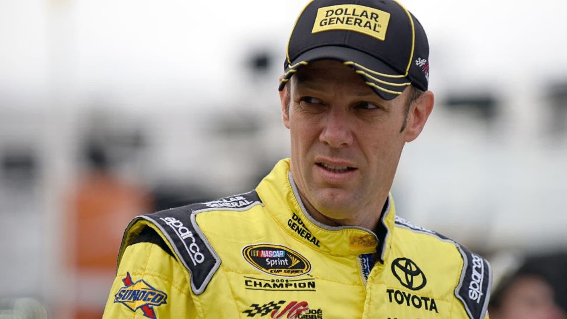 MARTINSVILLE, VA - OCTOBER 31: Matt Kenseth, driver of the #20 Dollar General Toyota, walks through the garage area during practice for the NASCAR Sprint Cup Series Goody's Headache Relief Shot 500 at Martinsville Speedway on October 31, 2015 in Martinsville, Virginia. (Photo by Jonathan Moore/Getty Images)