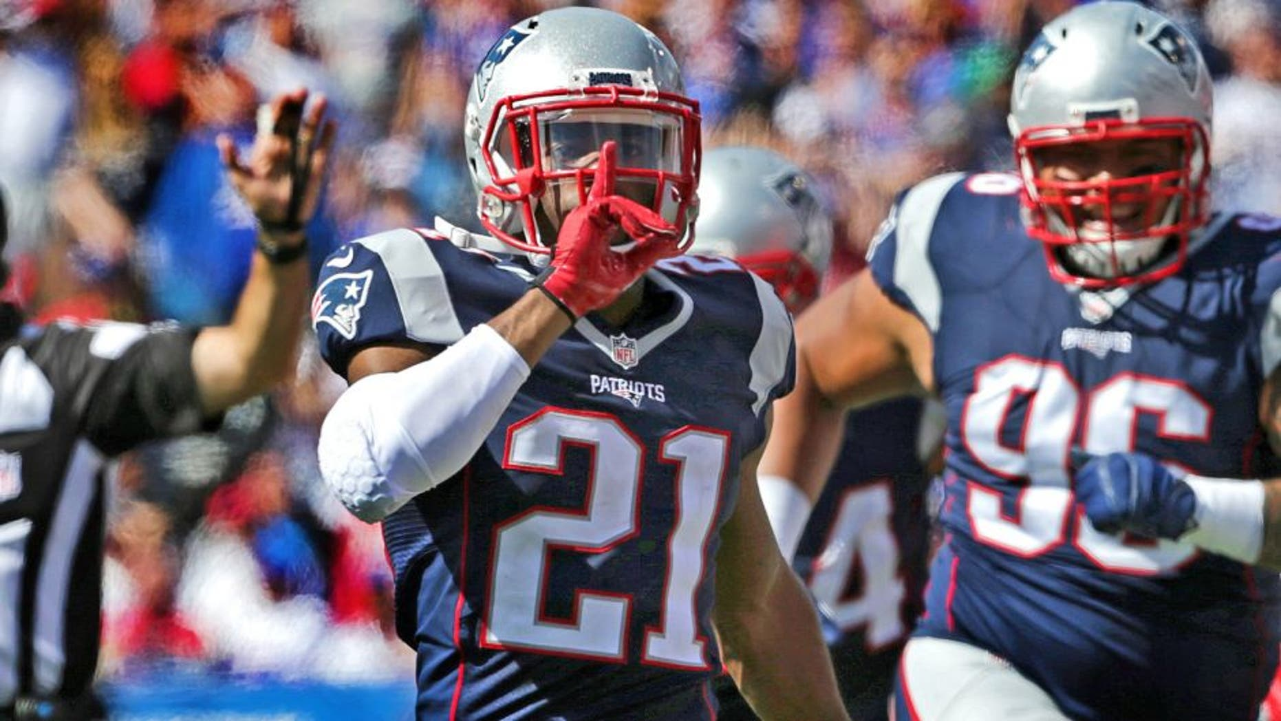 ORCHARD PARK, NY - SEPTEMBER 20: New England Patriots cornerback Malcolm Butler (#21) calls for silence after his interception on a deflection in the second quarter. The New England Patriots take on the Buffalo Bills at Ralph Wilson Stadium in Orchard Park, New York, Sept. 20, 2015. (Photo by Barry Chin/The Boston Globe via Getty Images)