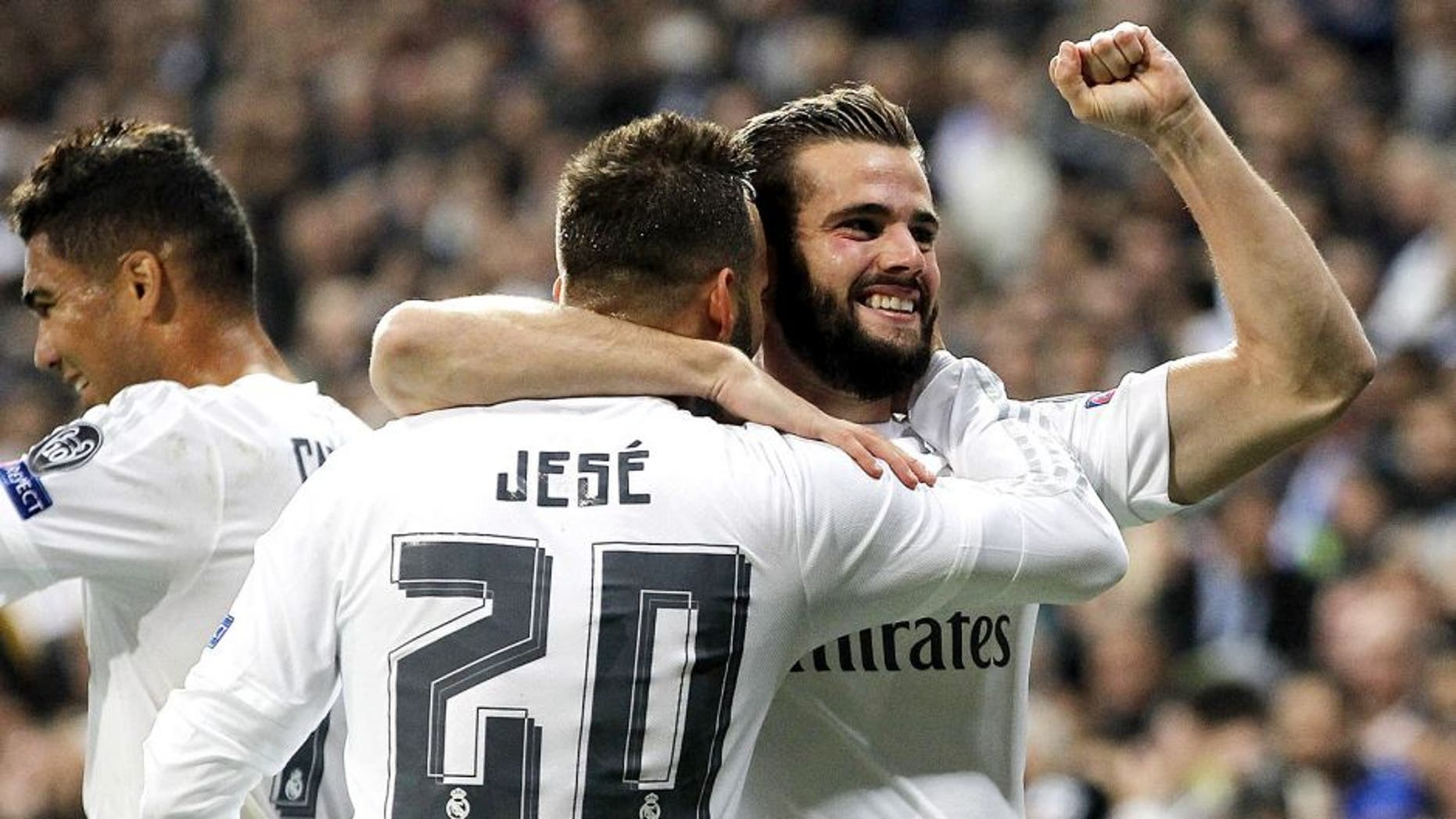 MADRID, SPAIN - NOVEMBER 03: Nacho Fernandez (R) of Real Madrid celebrates with Jese Rodriguez after scoring the opening goal during the UEFA Champions League Group A match between Real Madrid and Paris Saint-Germain at Estadio Santiago Bernabeu on November 3, 2015 in Madrid, Spain. (Photo by Angel Martinez/Real Madrid via Getty Images)