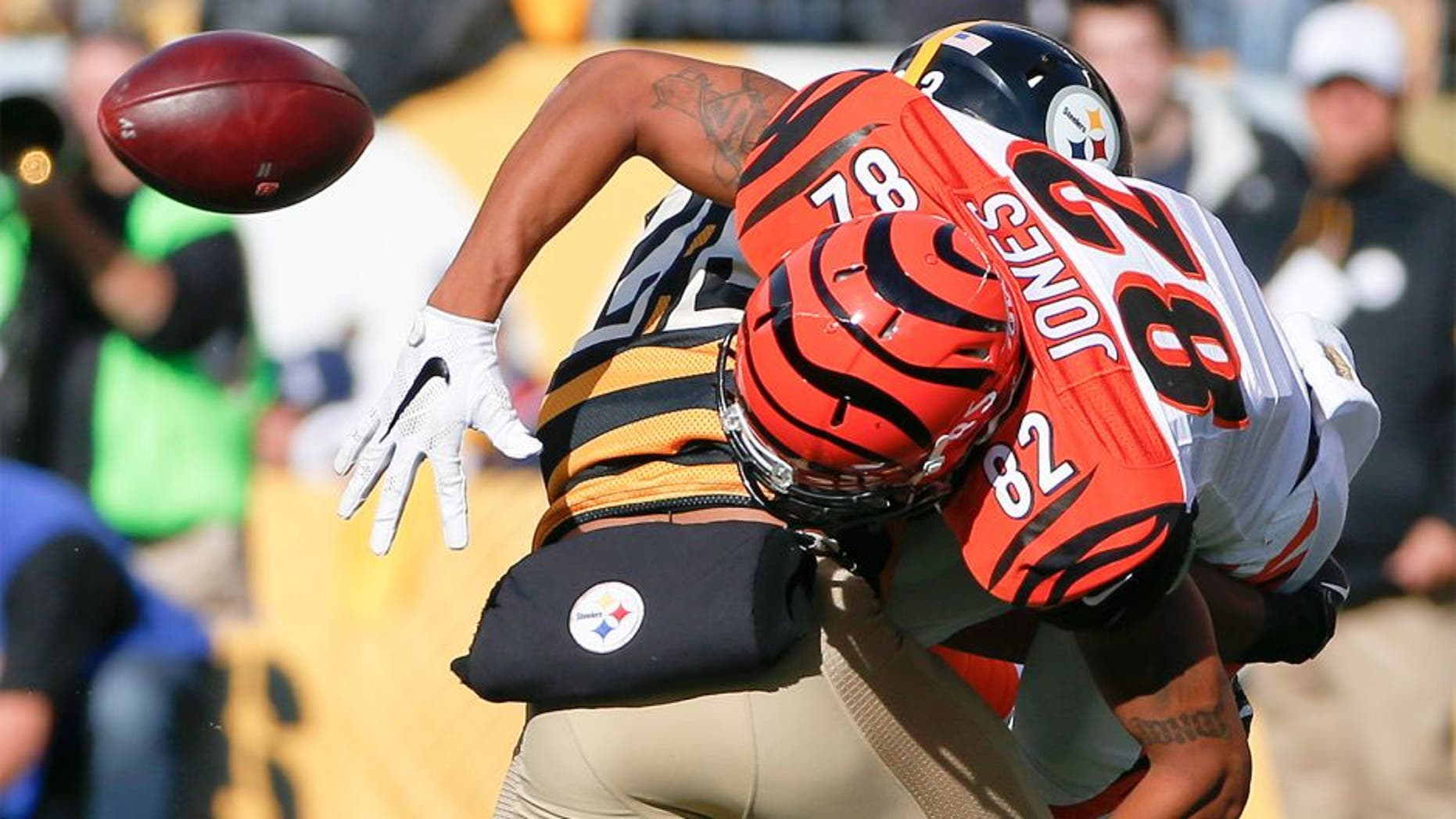 Pittsburgh Steelers free safety Mike Mitchell (23) breaks up a pass to Cincinnati Bengals wide receiver Marvin Jones (82) in the second quarter an NFL football game, Sunday, Nov. 1, 2015, in Pittsburgh. (AP Photo/Gene J. Puskar)