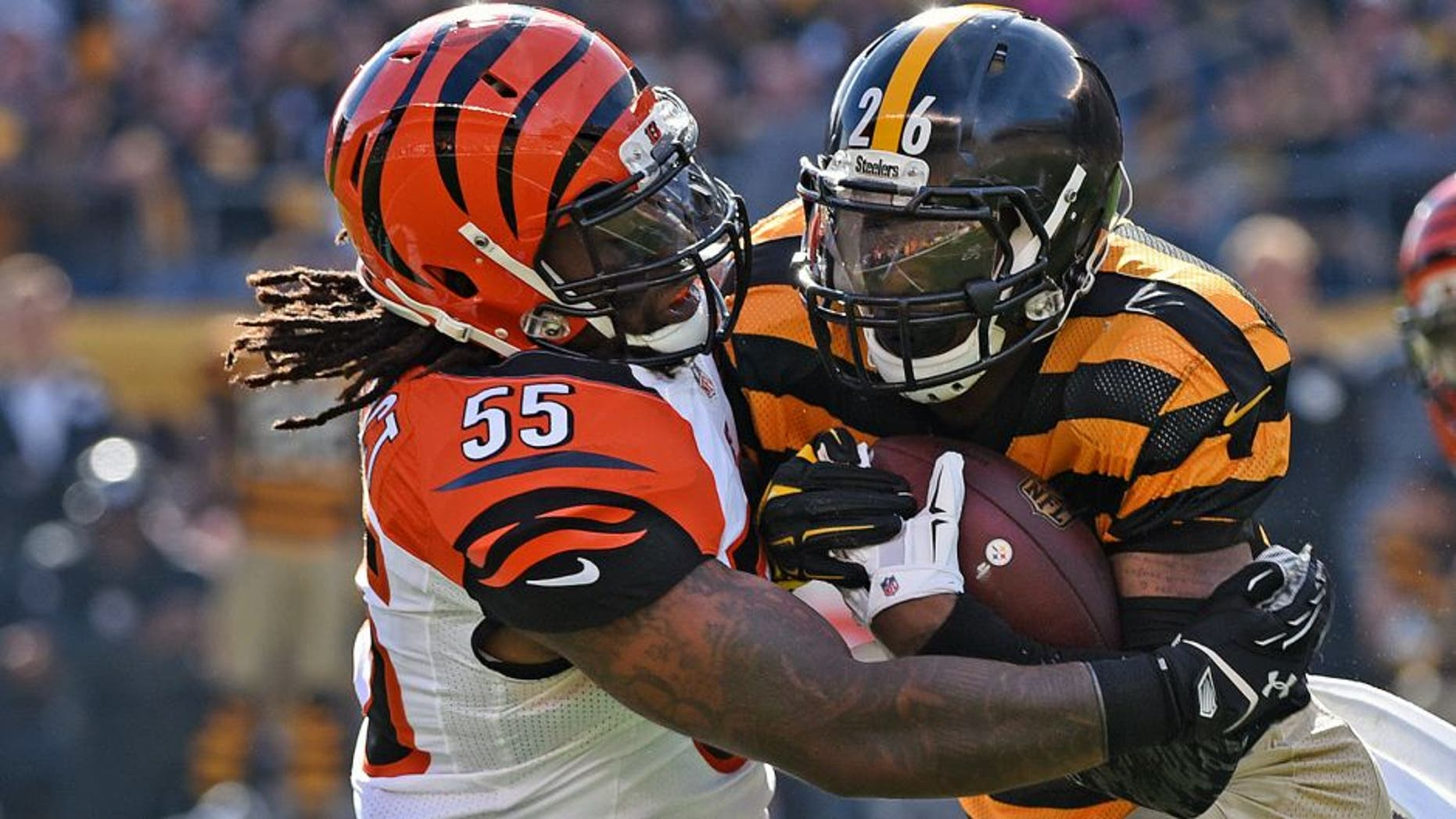 PITTSBURGH, PA - NOVEMBER 1: Linebacker Vontaze Burfict #55 of the Cincinnati Bengals tackles running back Le'Veon Bell #26 of the Pittsburgh Steelers during a game at Heinz Field on November 1, 2015 in Pittsburgh, Pennsylvania. The Bengals defeated the Steelers 16-10. (Photo by George Gojkovich/Getty Images)