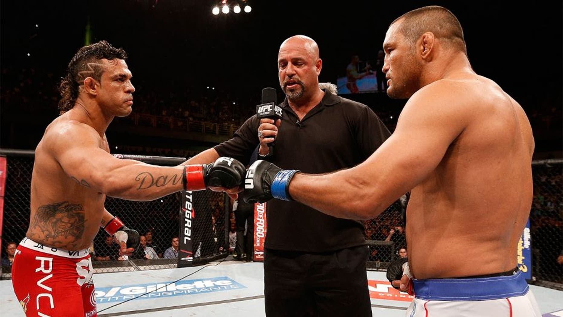 GOIANIA, BRAZIL - NOVEMBER 09: Opponents Vitor Belfort (L) and Dan Henderson (R) face off before their light heavyweight bout during the UFC event at Arena Goiania on November 9, 2013 in Goiania, Brazil. (Photo by Josh Hedges/Zuffa LLC/Zuffa LLC via Getty Images)