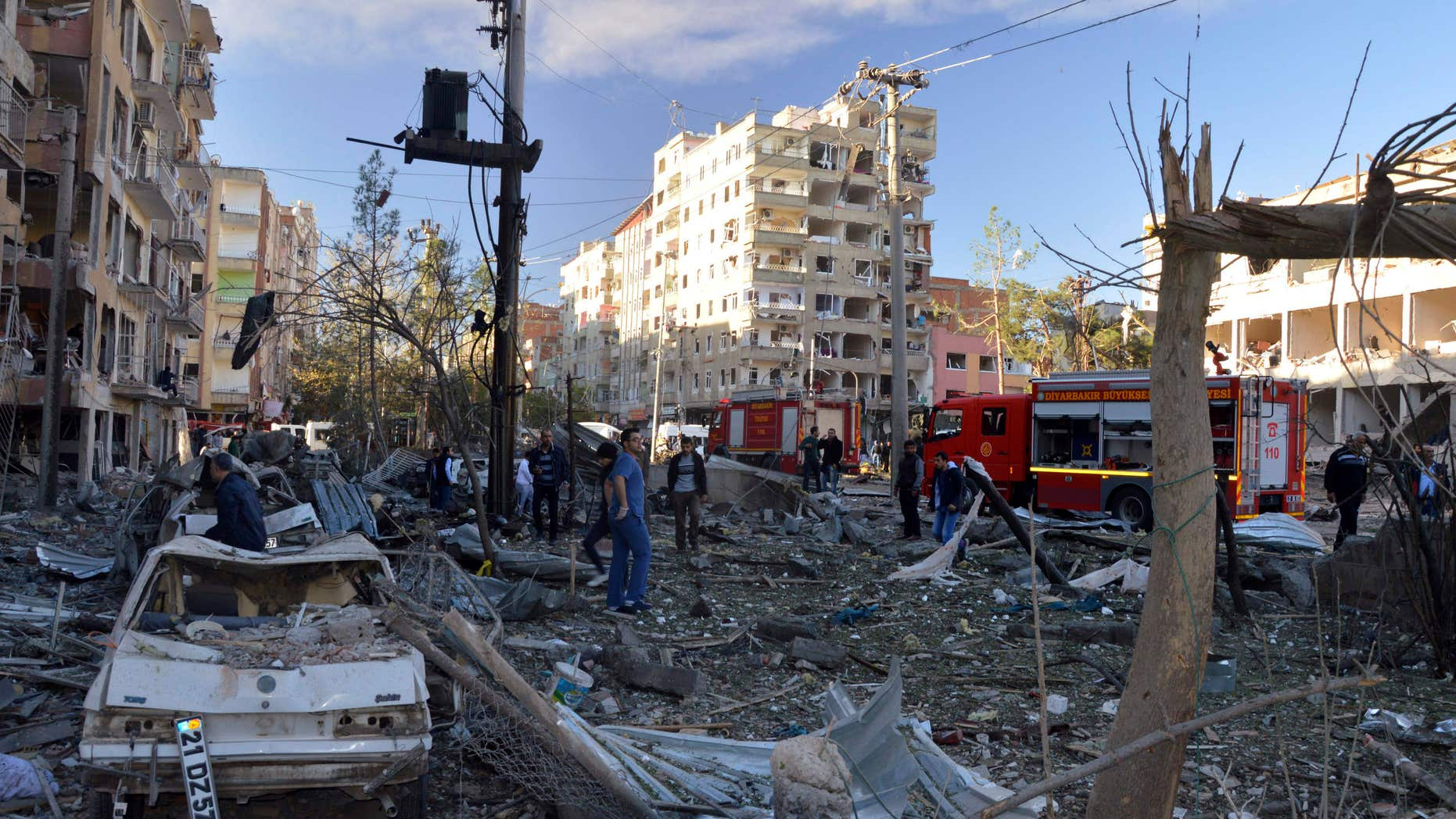 Nov. 4, 2016: People watch the damage after an explosion in southeastern Turkish city of Diyarbakir.