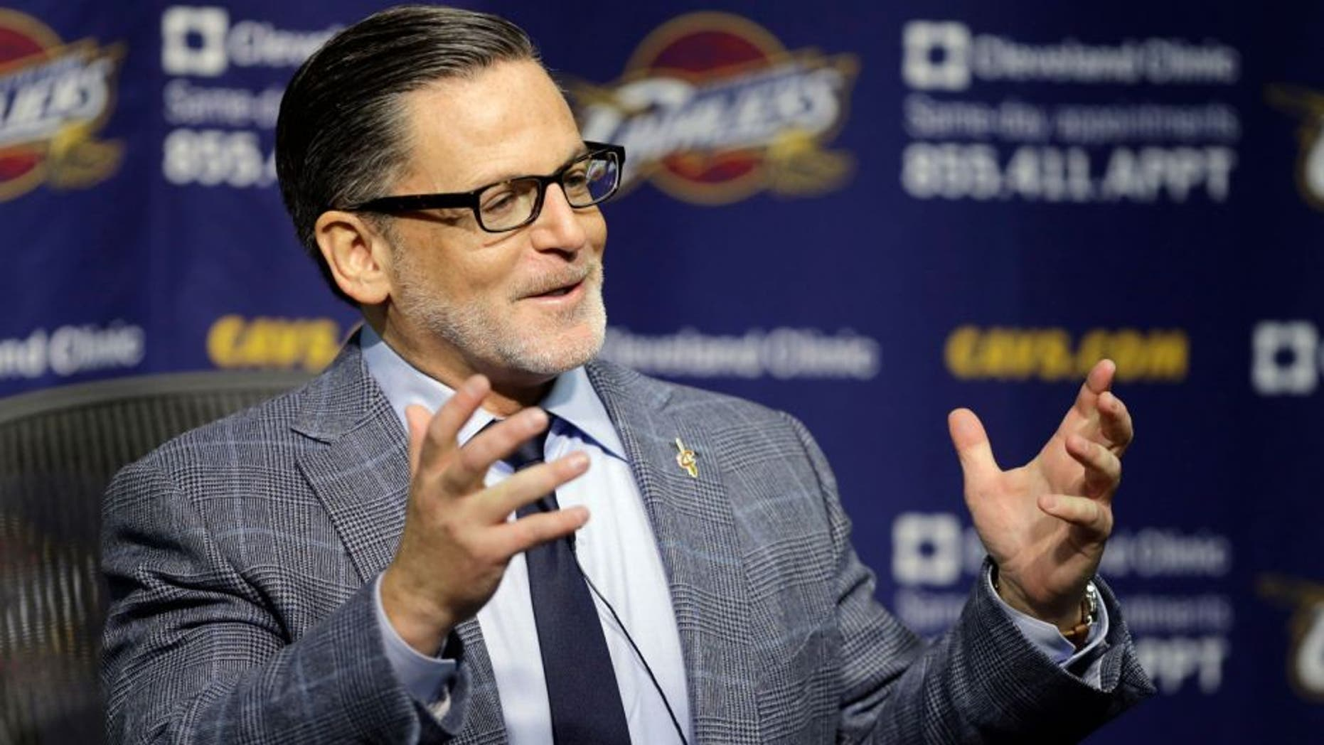 Cleveland Cavaliers owner Dan Gilbert answers questions during a news conference on the day before the NBA basketball team's opening game Wednesday, Oct. 29, 2014, in Cleveland. (AP Photo/Mark Duncan)