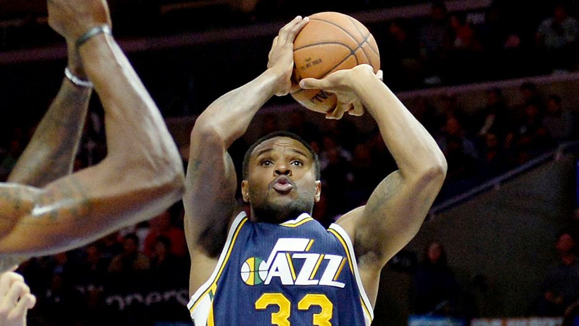 Nov 3, 2014; Los Angeles, CA, USA; Utah Jazz forward Trevor Booker (33) shoots the ball during the first half of a game against the Los Angeles Clippers at Staples Center. Mandatory Credit: Richard Mackson-USA TODAY Sports