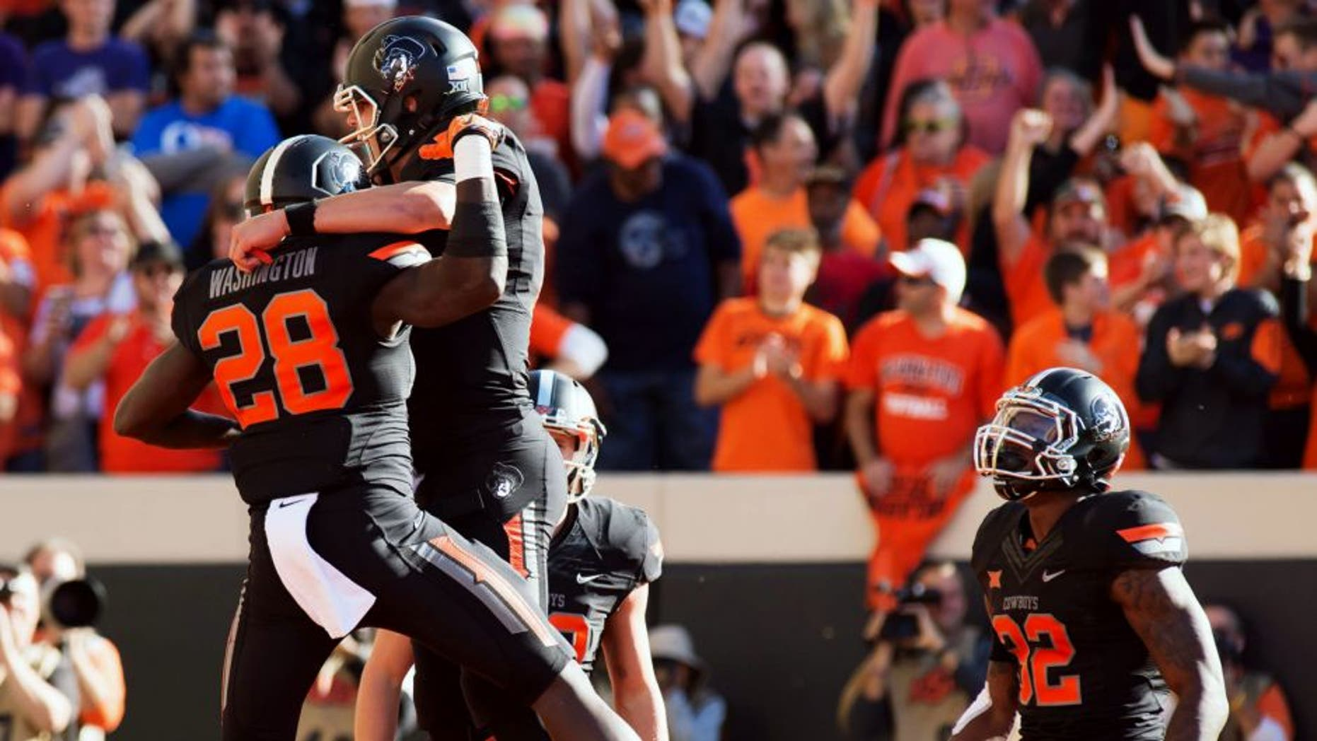 Nov 7, 2015; Stillwater, OK, USA; Oklahoma State Cowboys wide receiver James Washington (28) celebrates a touchdown against the TCU Horned Frogs during the first quarter at Boone Pickens Stadium. Mandatory Credit: Rob Ferguson-USA TODAY Sports