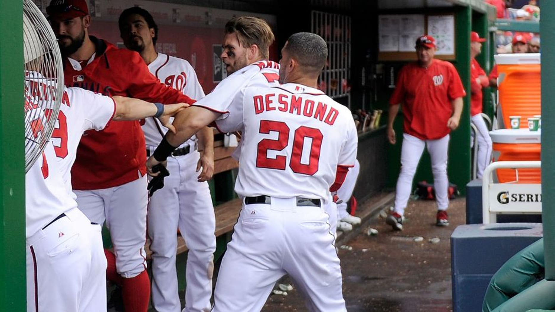 WASHINGTON, DC - SEPTEMBER 27: Bryce Harper #34 of the Washington Nationals is pulled away by Ian Desmond #20 after an altercation with Jonathan Papelbon #58 (not pictured) in the eighth inning against the Philadelphia Phillies at Nationals Park on September 27, 2015 in Washington, DC. (Photo by Greg Fiume/Getty Images)