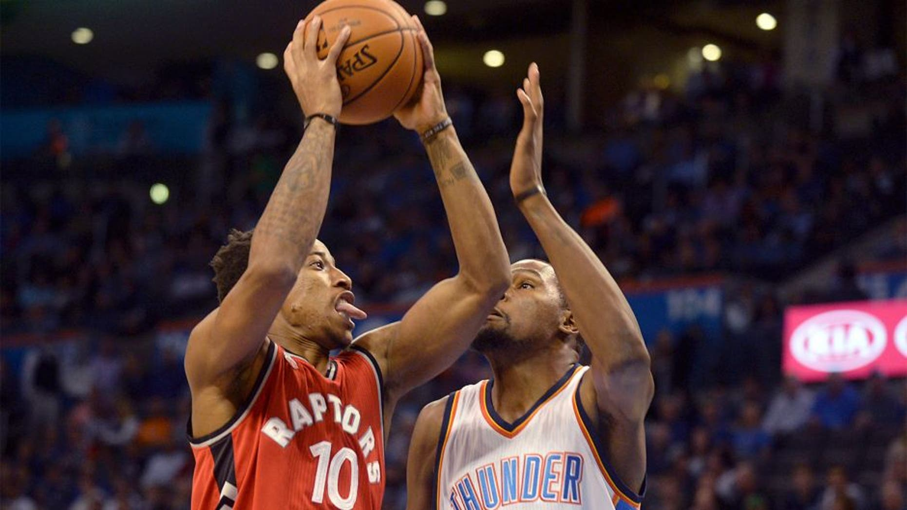 Nov 4, 2015; Oklahoma City, OK, USA; Toronto Raptors guard DeMar DeRozan (10) attempts a shot against Oklahoma City Thunder forward Kevin Durant (35) during the first quarter at Chesapeake Energy Arena. Mandatory Credit: Mark D. Smith-USA TODAY Sports