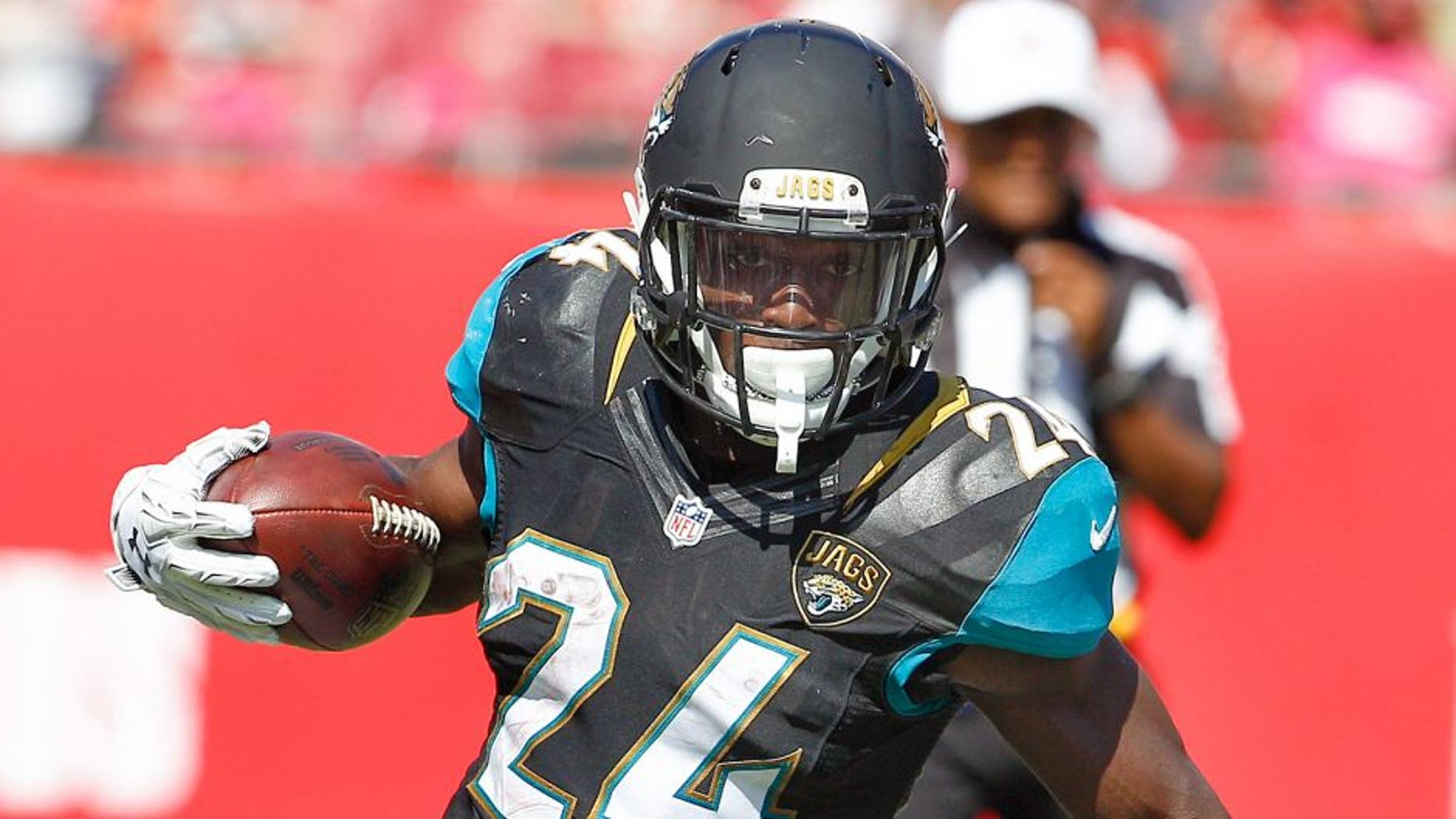Oct 11, 2015; Tampa, FL, USA; Jacksonville Jaguars running back T.J. Yeldon (24) runs the ball during the second half of an NFL football game against the Tampa Bay Buccaneers at Raymond James Stadium. Tampa won 38-31. Mandatory Credit: Reinhold Matay-USA TODAY Sports