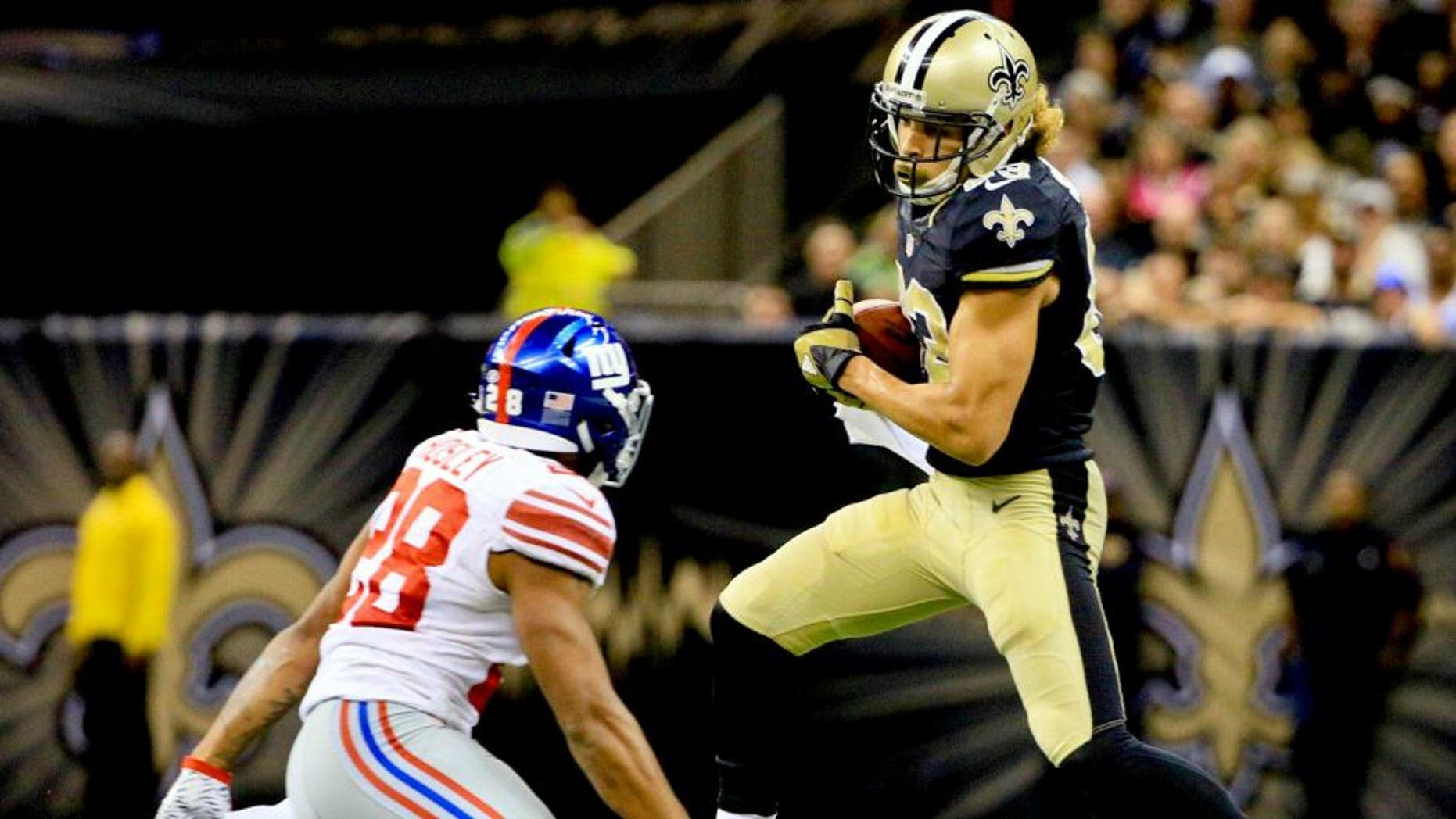 Nov 1, 2015; New Orleans, LA, USA; New Orleans Saints wide receiver Willie Snead (83) catches a pass in front of New York Giants cornerback Jayron Hosley (28) during the fourth quarter of a game at the Mercedes-Benz Superdome. The Saints defeated the Giants 52-49. Mandatory Credit: Derick E. Hingle-USA TODAY Sports