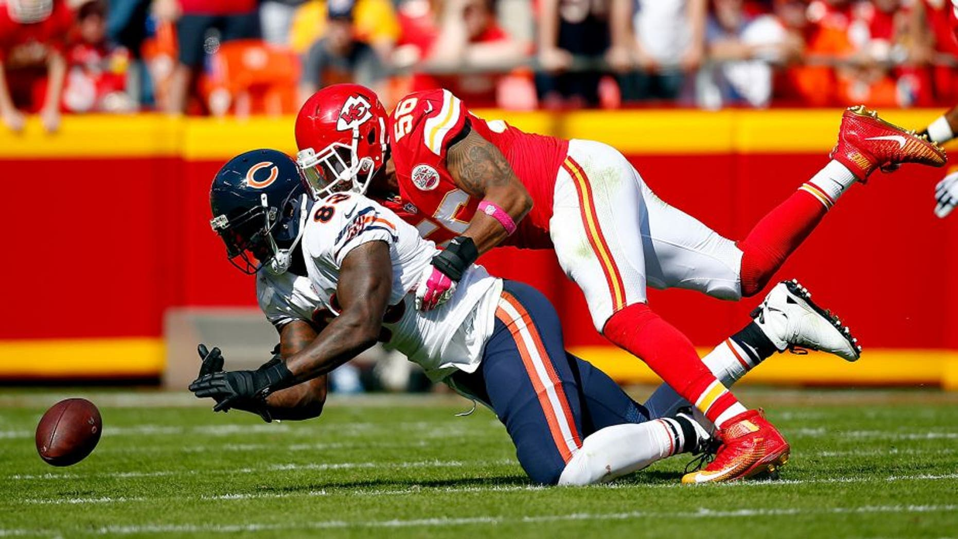 KANSAS CITY, MO - OCTOBER 11: Inside linebacker Derrick Johnson #56 of the Kansas City Chiefs breaks up a pass intended for tight end Martellus Bennett #83 of the Chicago Bears during the game at Arrowhead Stadium on October 11, 2015 in Kansas City, Missouri. (Photo by Jamie Squire/Getty Images)