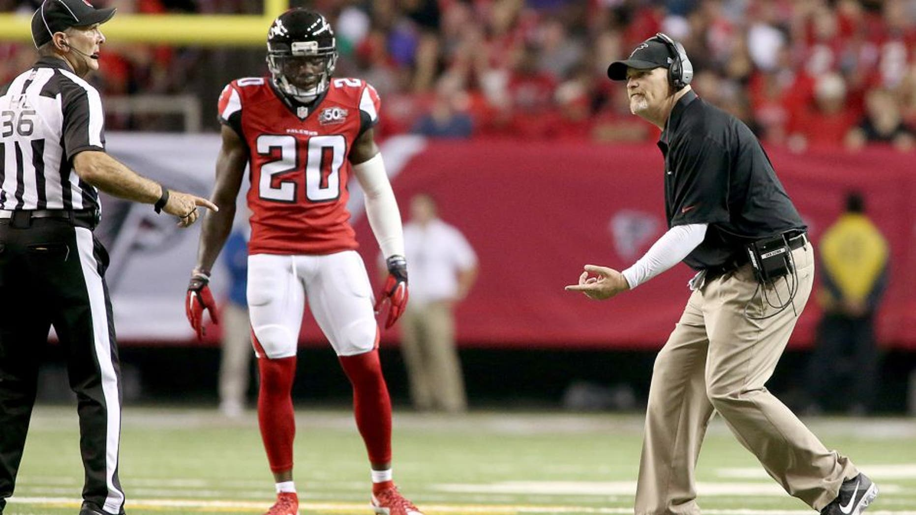 Nov 1, 2015; Atlanta, GA, USA; Atlanta Falcons head coach Dan Quinn argues a call with official Tony Veteri (36) as defensive back Phillip Adams (20) watches in the fourth quarter of their game against the Tampa Bay Buccaneers at the Georgia Dome. The Buccaneers won 23-20 in overtime. Mandatory Credit: Jason Getz-USA TODAY Sports