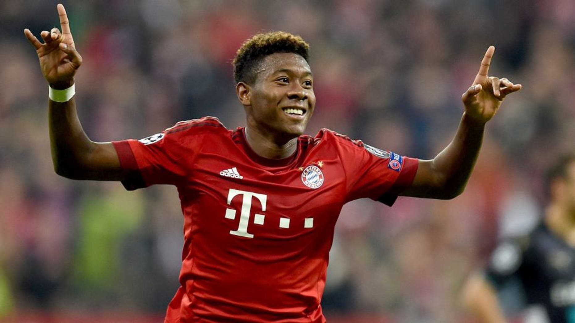 Bayern Munich's Austrian defender David Alaba celebrates after scoring the third goal during the UEFA Champions League Group F second-leg football match between FC Bayern Munich and Arsenal FC in Munich, southern Germany, on November 4, 2015. AFP PHOTO / CHRISTOF STACHE (Photo credit should read CHRISTOF STACHE/AFP/Getty Images)