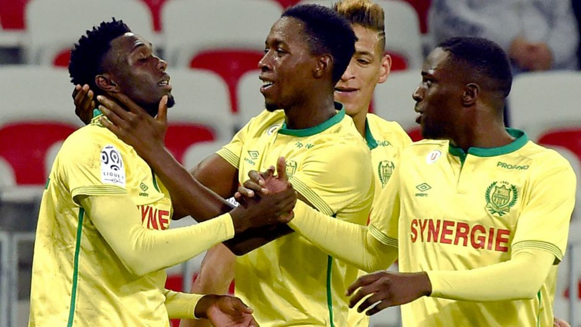 Nantes' forward Alexis Alegue Elandi (L) celebrates with teammates after scoring a goal during the French Ligue 1 football match between Nice and Nantes, on November 4, 2015 at the Allianz Riviera Stadium in Nice, southern France.. AFP PHOTO / ANNE-CHRISTINE POUJOULAT (Photo credit should read ANNE-CHRISTINE POUJOULAT/AFP/Getty Images)