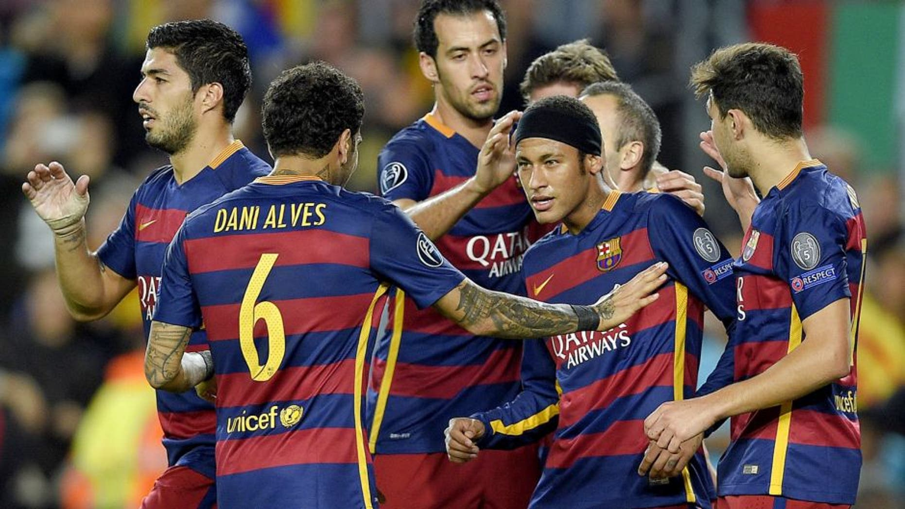 Barcelona's Brazilian forward Neymar (2ndR) celebrates with his teammates after scoring a goal during the UEFA Champions League group E football match FC Barcelona vs FC BATE Borisov at the Camp Nou stadium in Barcelona on November 4, 2015. AFP PHOTO/ LLUIS GENE (Photo credit should read LLUIS GENE/AFP/Getty Images)