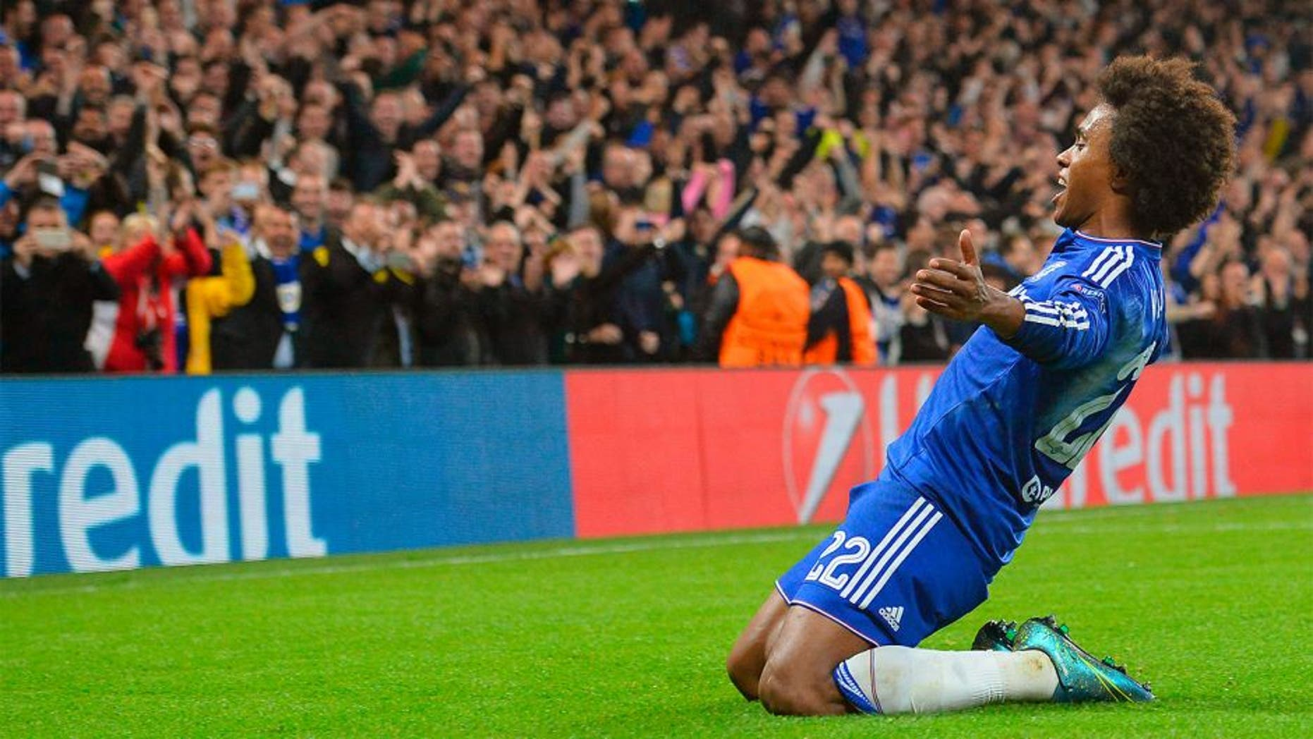 Chelsea's Brazilian midfielder Willian celebrates after scoring from a free kick during a UEFA Chamions league group stage football match between Chelsea and Dynamo Kiev at Stamford Bridge stadium in west London on November 4, 2015. AFP PHOTO / GLYN KIRK (Photo credit should read GLYN KIRK/AFP/Getty Images)