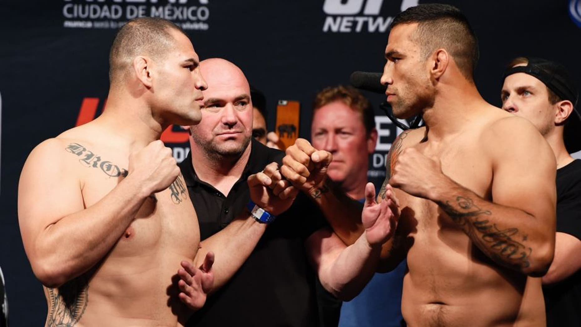 MEXICO CITY, MEXICO - JUNE 12: (L-R) Cain Velasquez of the United States and Fabricio Werdum of Brazil face off during the UFC 188 weigh-in inside the Arena Ciudad de Mexico on June 12, 2015 in Mexico City, Mexico. (Photo by Josh Hedges/Zuffa LLC/Zuffa LLC via Getty Images)