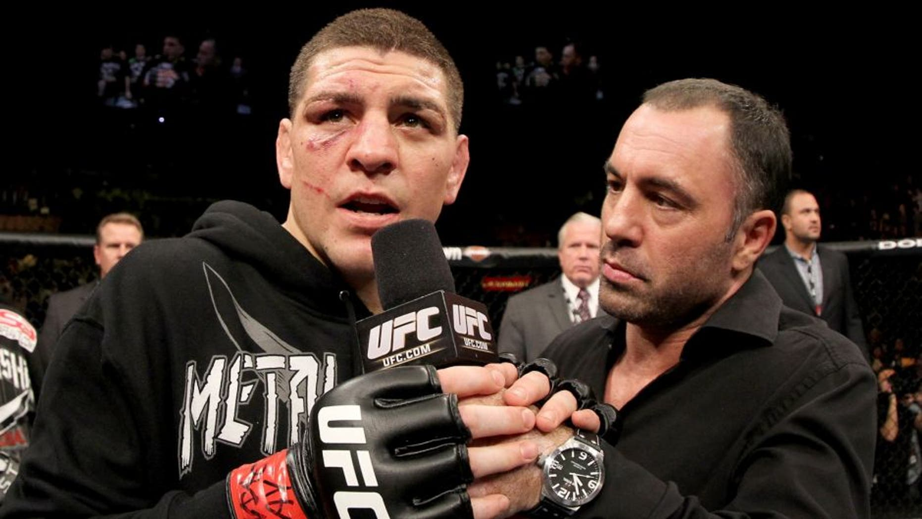 LAS VEGAS, NV - FEBRUARY 04: Nick Diaz (L) is interviewed by Joe Rogan after his victory over Nick Diaz during the UFC 143 event at Mandalay Bay Events Center on February 4, 2012 in Las Vegas, Nevada. (Photo by Josh Hedges/Zuffa LLC/Zuffa LLC via Getty Images)