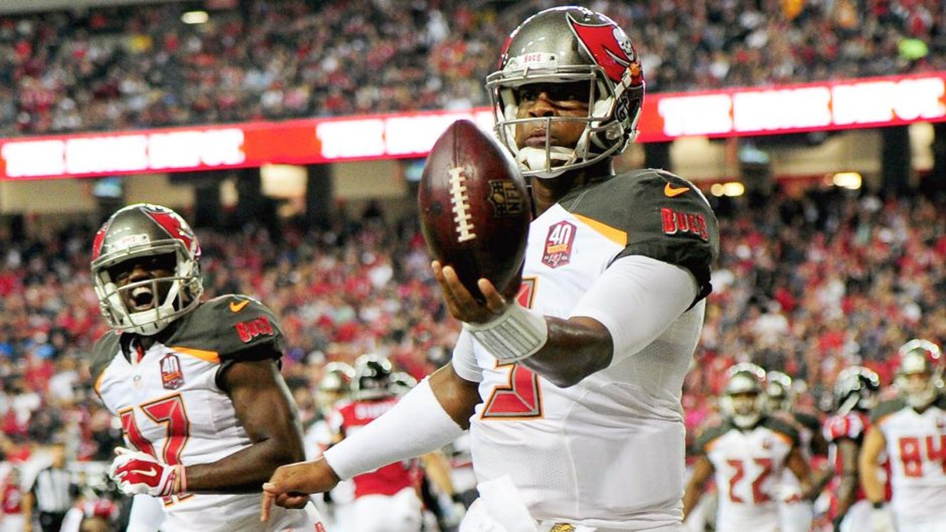 Jameis Winston #3 of the Tampa Bay Buccaneers celebrates a rushing touchdown during the second half against the Atlanta Falcons at the Georgia Dome on November 1, 2015 in Atlanta, Georgia. (Photo by Scott Cunningham/Getty Images)