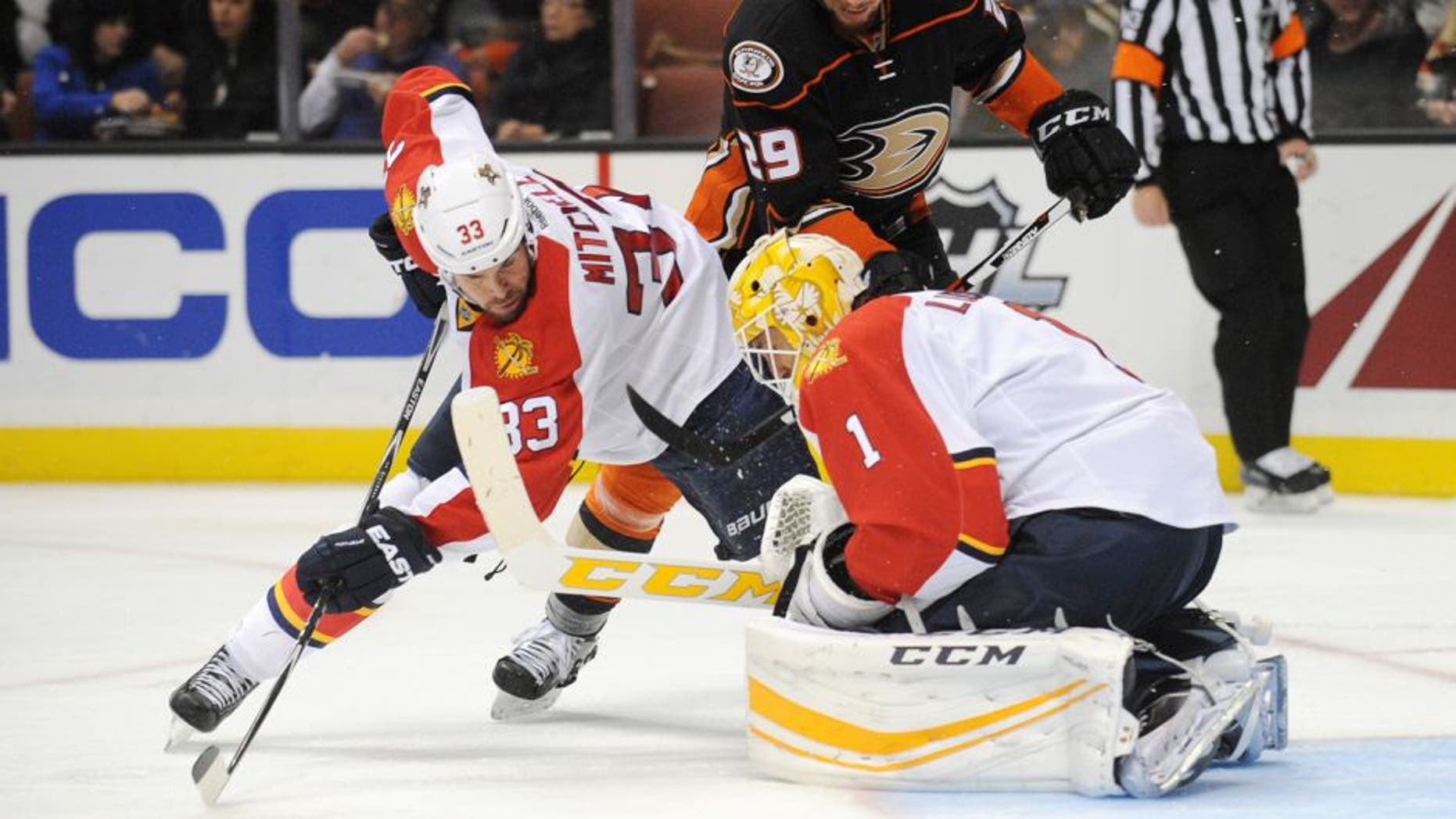 November 4, 2015; Anaheim, CA, USA; Florida Panthers defenseman Willie Mitchell (33) helps goalie Roberto Luongo (1) defend the goal against Anaheim Ducks right wing Chris Stewart (29) during the second period at Honda Center. Mandatory Credit: Gary A. Vasquez-USA TODAY Sports
