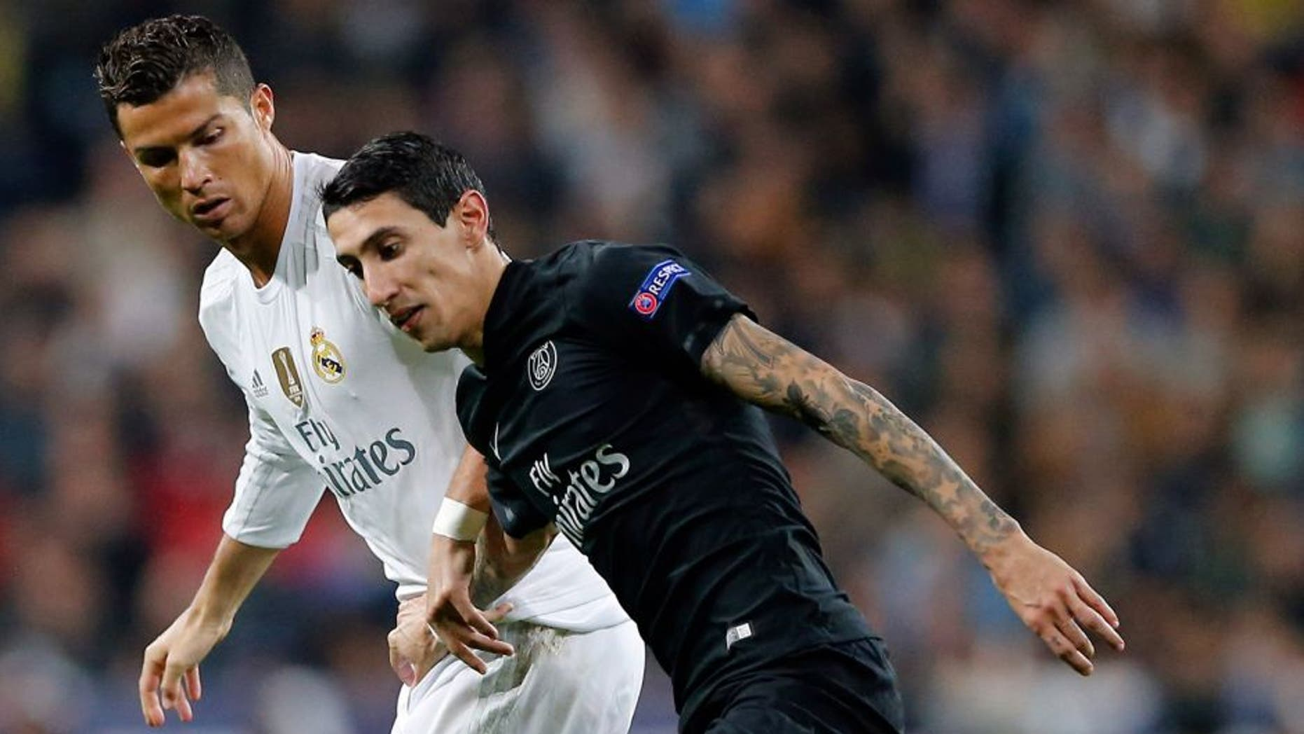 MADRID, SPAIN - NOVEMBER 03: Cristiano Ronaldo (L) of Real Madrid and Angel Di Maria of PSG compete for the ball during the UEFA Champions League Group A match between Real Madrid and Paris Saint-Germain at Estadio Santiago Bernabeu on November 3, 2015 in Madrid, Spain. (Photo by Helios de la Rubia/Real Madrid via Getty Images)
